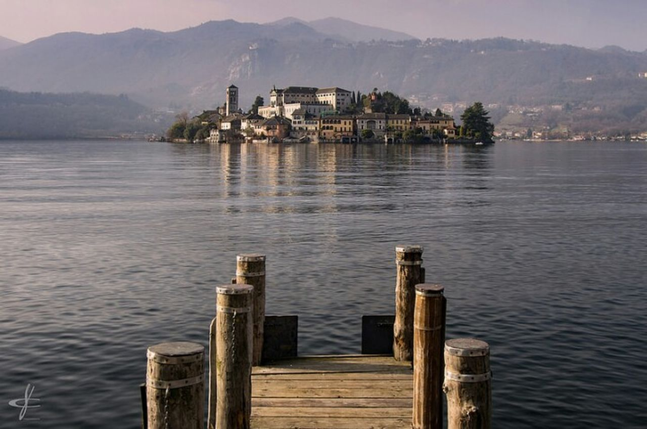 tepid winter lights Orta  Lake Orta San Giulio Lake View Orta S.Giulio Lakescape Piemonte Piemonte_super_pics Piedmont Italy Italy Water Outdoors Travel Destinations Nature Mountain Landscape Island View  Little Island Little Town Village Tourist Place Tourism Exploring New Ground Rural Exploration Countryside