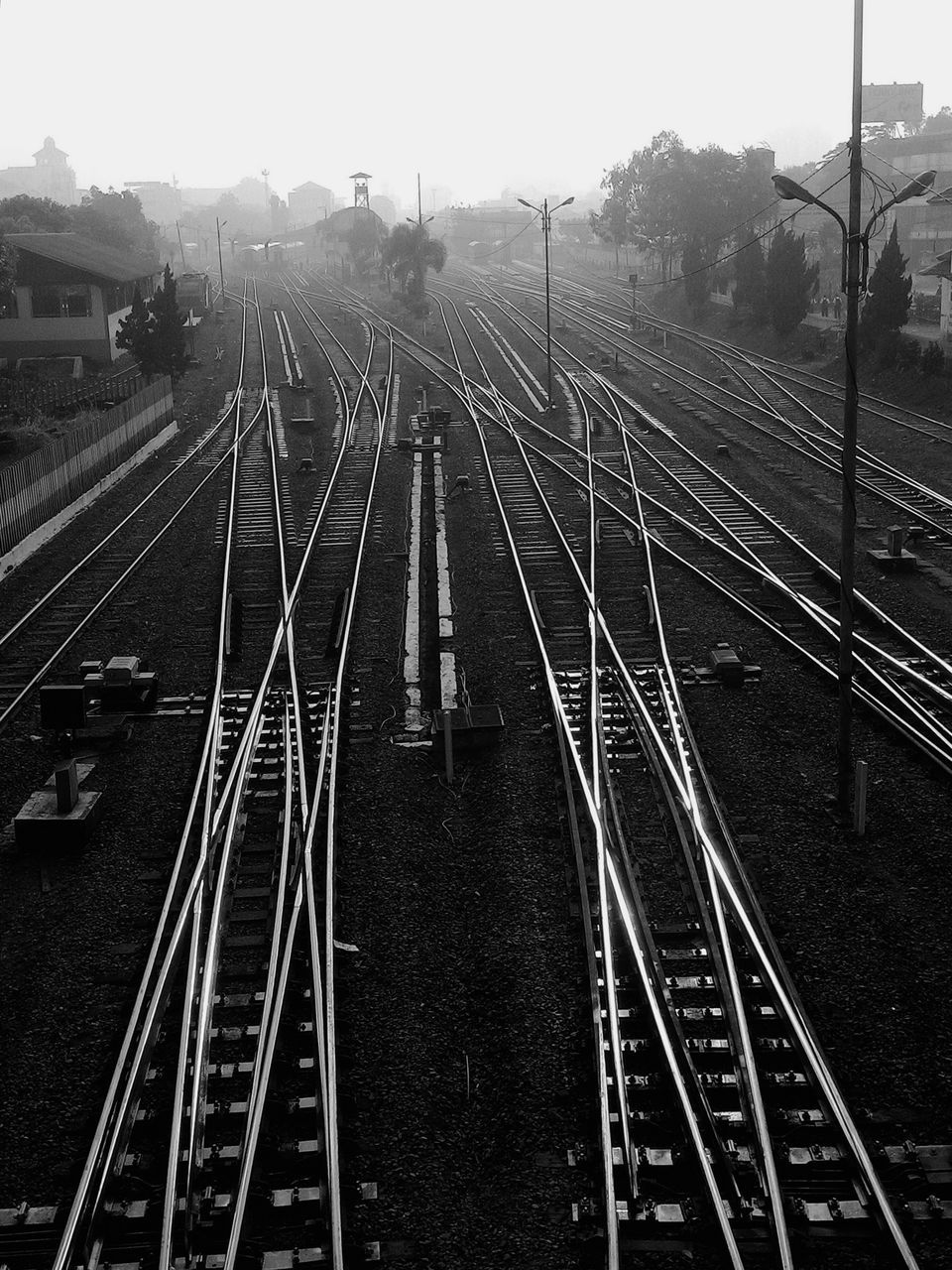 High Angle View Of Railway Tracks Against Clear Sky