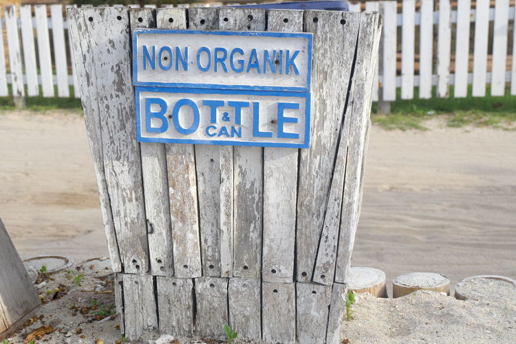 Dustbin for non organic bottle can trash Beach Disposal Dustbin Garbage Garbage Bin Garbage Can Gili Trawangan Gili Trawangan-lombok Junk Litter Lombok Indonesia Non Organic Object Outdoors Recycle Recycling Text Trash Can Waste Wood - Material