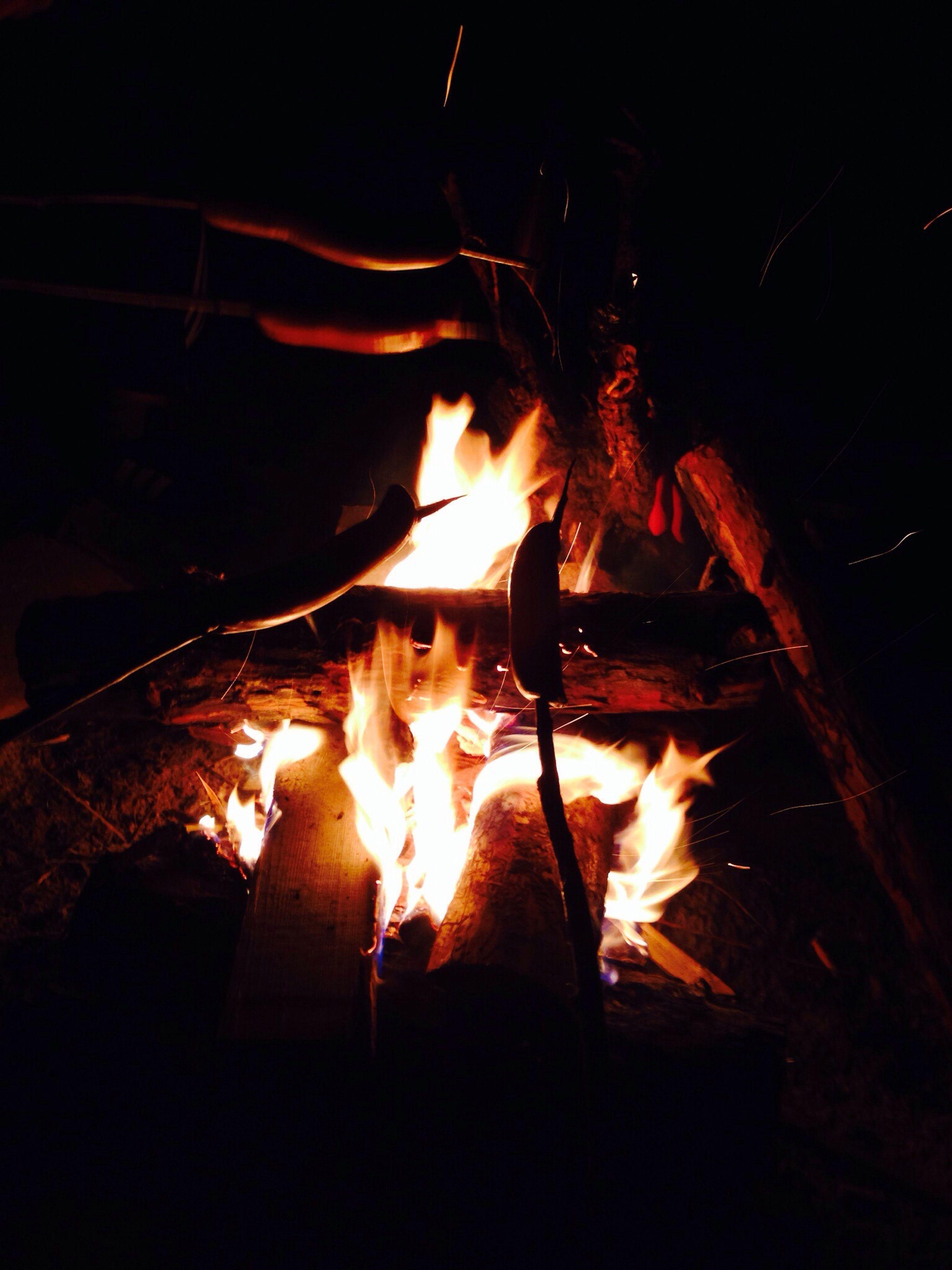 burning, flame, fire - natural phenomenon, heat - temperature, night, bonfire, glowing, fire, firewood, campfire, heat, illuminated, motion, dark, wood - material, orange color, fireplace, close-up, light - natural phenomenon, indoors