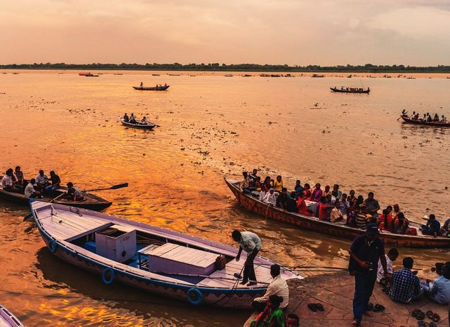 Boat Mode Of Transport Scenics Large Group Of People Tranquil Scene Vacations Riverbank Weekend Activities Sky Ganga Ghat Traveling Outdoor Photography India Sale Colors Sunset_madness Sunset Lovers Sunlight And Shadows Calm High Angle View Colour Of Life Landscape
