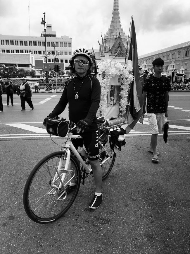 Adult Bicycle Black And White City Cycling Cycling Helmet Day Full Length Grand Palace Bangkok Thailand Headwear King Bhumipol Adulyadet Men Only Men Outdoors People Person Transportation Vertical