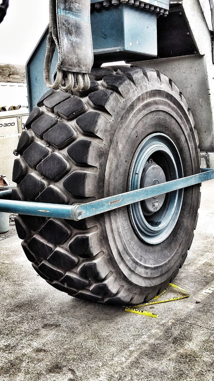 tire, wheel, transportation, mode of transport, rubber, land vehicle, vehicle part, stationary, outdoors, day, no people