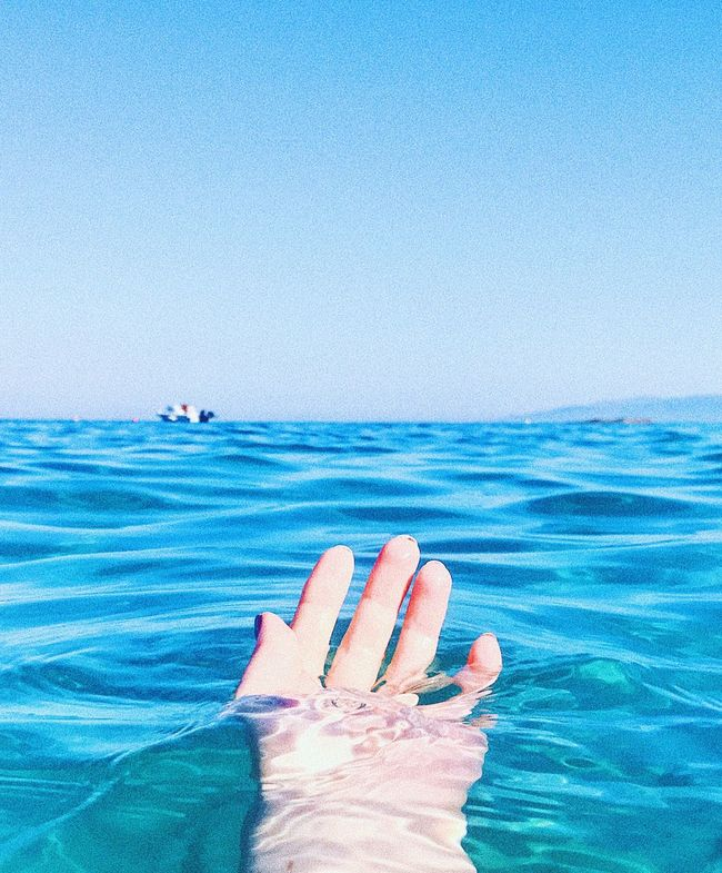 Blue Human Body Part Sea Human Hand Water One Person Day Horizon Over Water Outdoors Vacations Beach Nail Polish Adult People Sky Nature One Woman Only Close-up Hand Relax