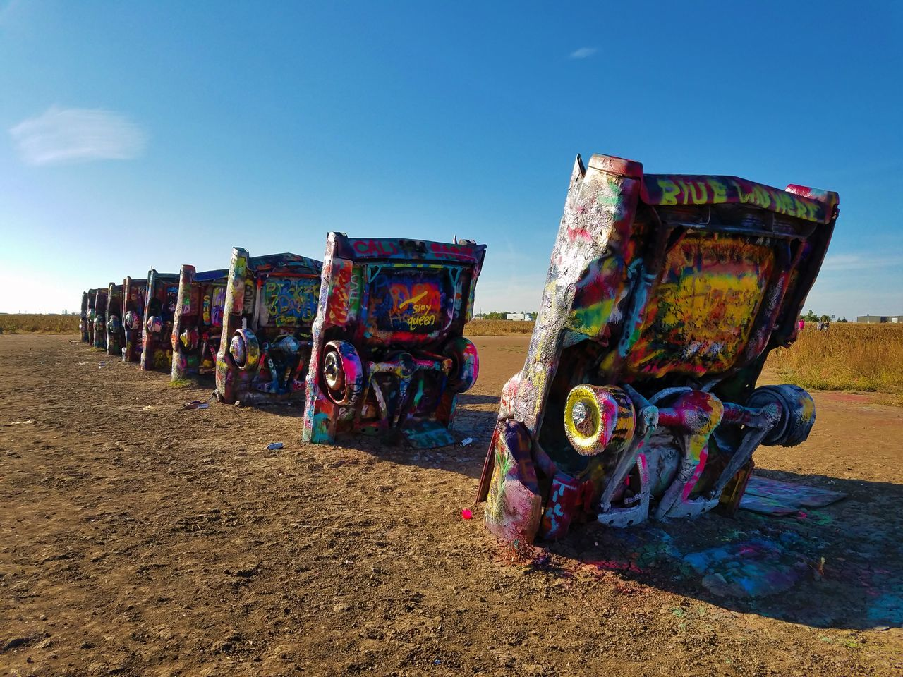Arid Climate Art Cadillac Colorful Day Desert Landscape Multi Colored No People Odd Outdoors Sky Spray Paint Sunlight