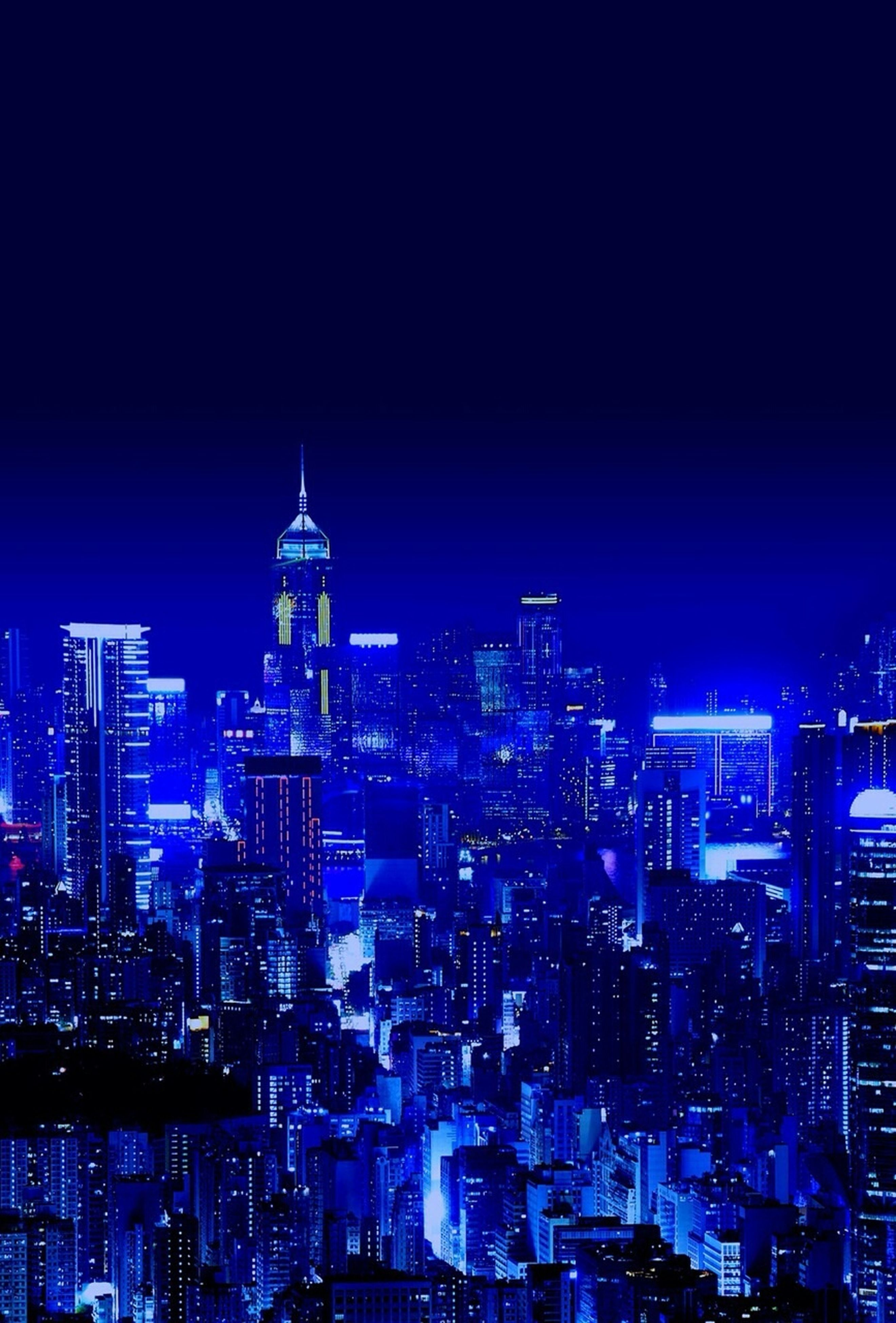 cityscape, city, building exterior, architecture, illuminated, night, built structure, skyscraper, tower, crowded, tall - high, modern, clear sky, office building, capital cities, copy space, high angle view, city life, travel destinations, financial district