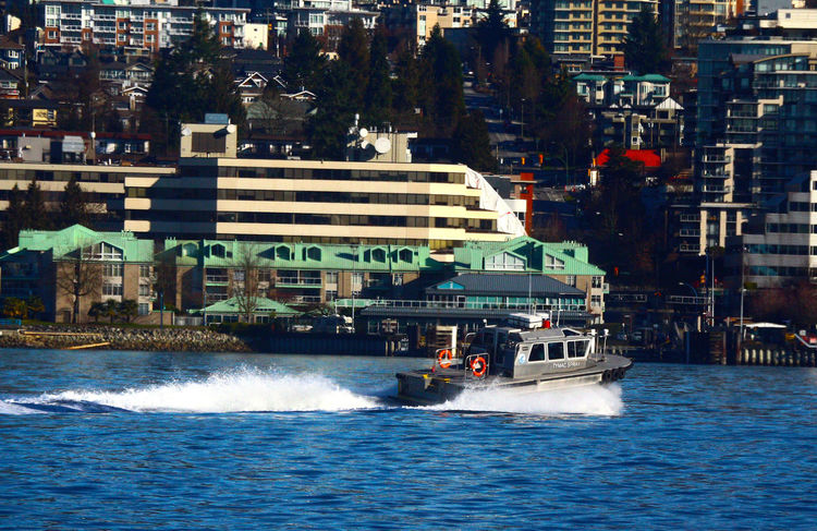 Boat traveling around high speed near Lonsdale Quay in North Vancouver B.C. Lonsdale Quay North Vancouver Canada High Speed Transportation Nautical Vessel Water Building Exterior Architecture Sea Outdoors