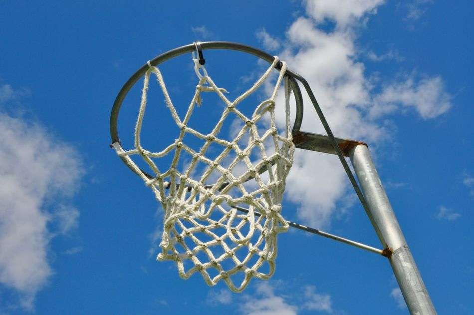 Upward perspective of a netball hoop and stand with a blue sky and cloud background in Western Australia. Abstract Australian Sports Basketball Basketball Hoop Blue Cloud Cloud - Sky Day Dreaming Hoop Low Angle View Net Netball Outdoors Perspective Pole Rope Sky Sports Sports Photography Team Sport The Color Of Sport View From Below Western Australia Woven