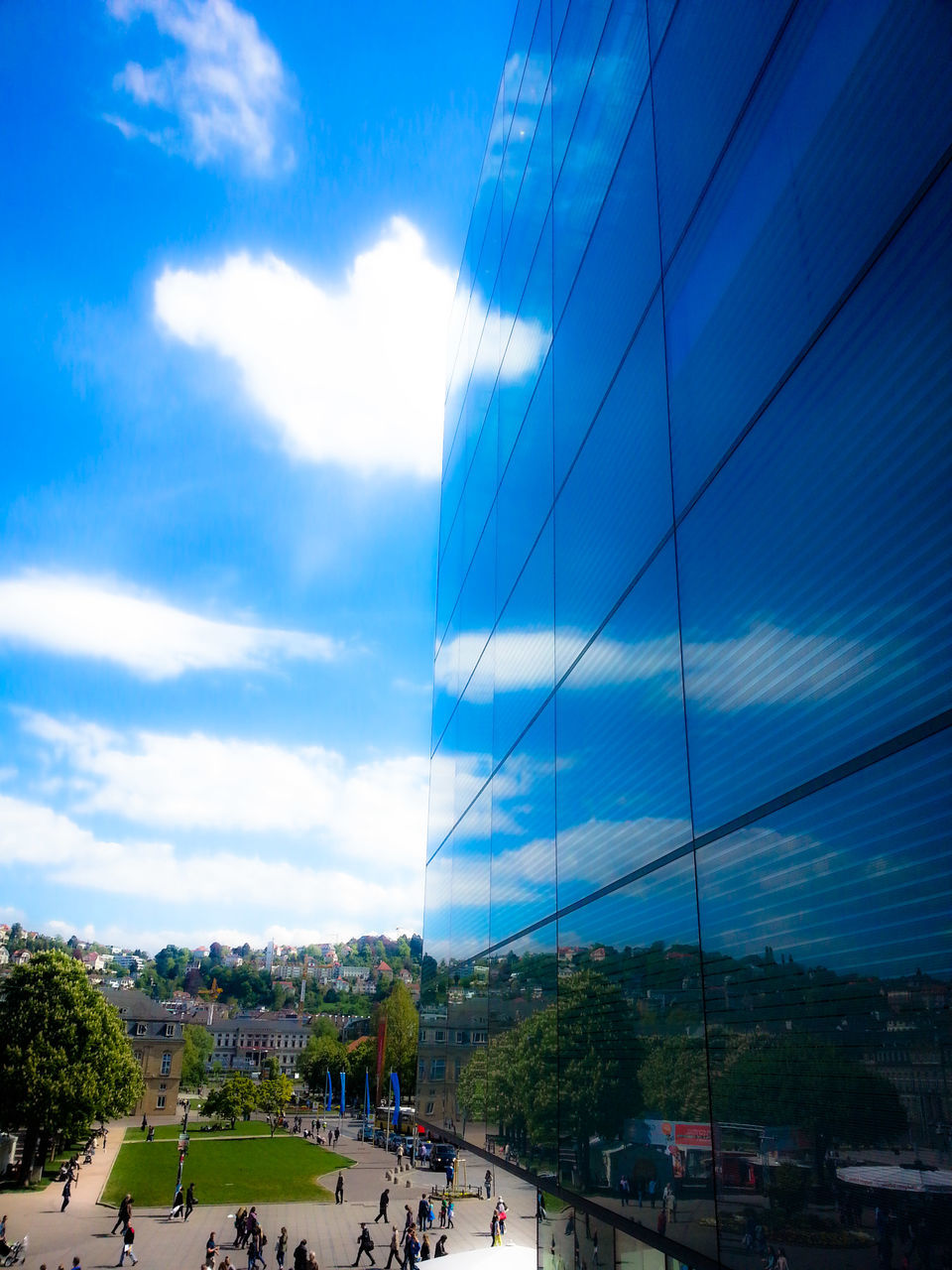 Reflection Of Blue Sky On Modern Buildings In City