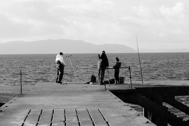 Fishing Fishermen Hanging Out Enjoying Life Relaxing Ayrshire, Scotland Scenic Scenery Sea Jetty Portencross Arran View Arran  Black And White Black & White Black And White Photography Fishing Fishing Time Fishing Rods Sea Fishing Breathing Space