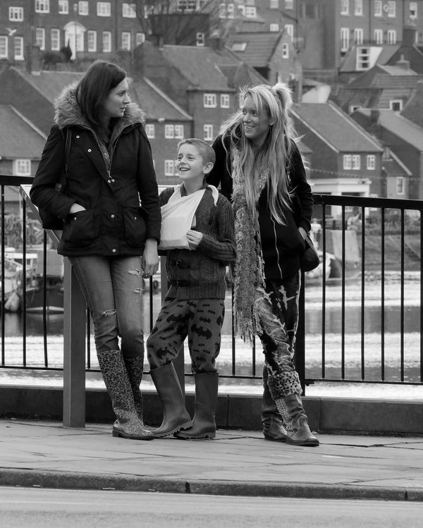 Street Photograhpy Streetlife Black And White Monochrome Photography Family Fashion Harbour Side Bridge Railings Outdoors Dayout Women Broken Arm Sling Young Boy Candid Picsartrefugees The Street Photographer - 2016 EyeEm Awards