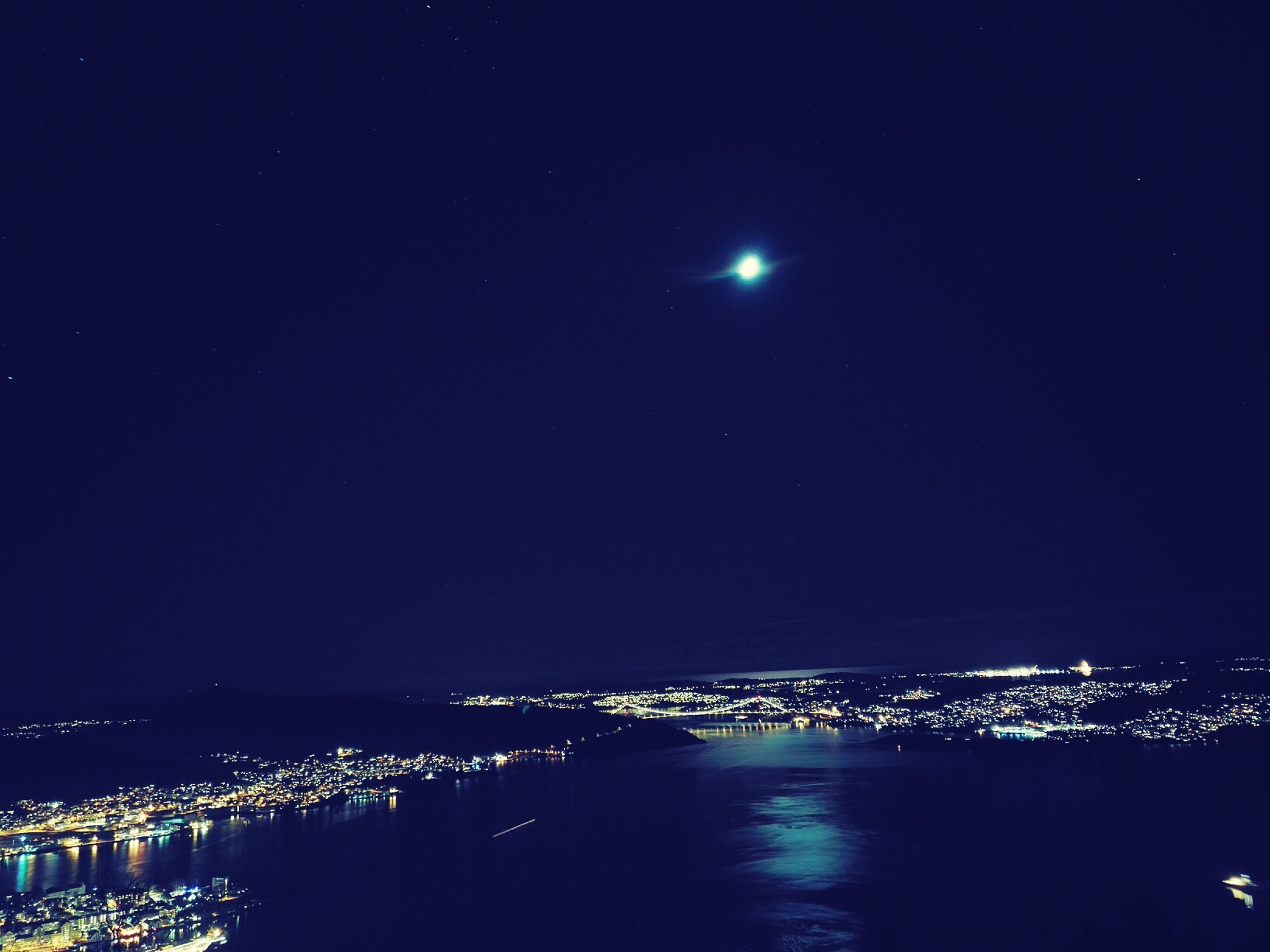 night, illuminated, cityscape, city, moon, architecture, built structure, building exterior, water, sky, sea, waterfront, river, copy space, full moon, light, clear sky, dark, scenics, outdoors