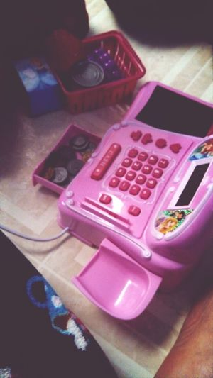 Lily's rich with fake money in her cash register!