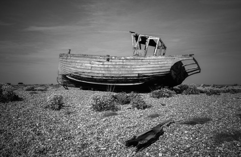 abandoned Abandoned Beach Boat Calm Cloud Coastline Day Discard Fishing Boat Mode Of Transport Moored Nature Nautical Vessel Non Urban Scene Ocean Outdoors Sand Sea Ship Shore Sky Tranquil Scene Tranquility Transportation Water
