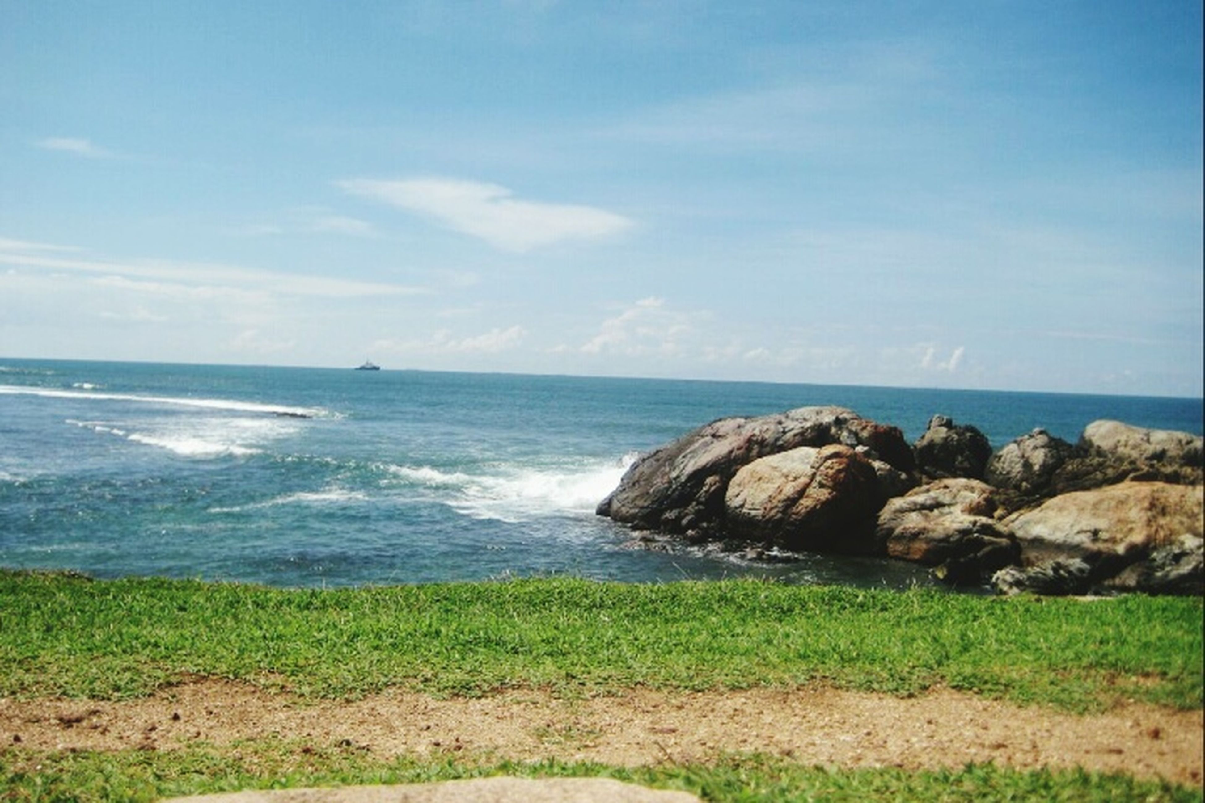 sea, horizon over water, beach, scenics, nature, sky, water, beauty in nature, wave, no people, day, outdoors, cloud - sky, grass, sand, tranquility, landscape