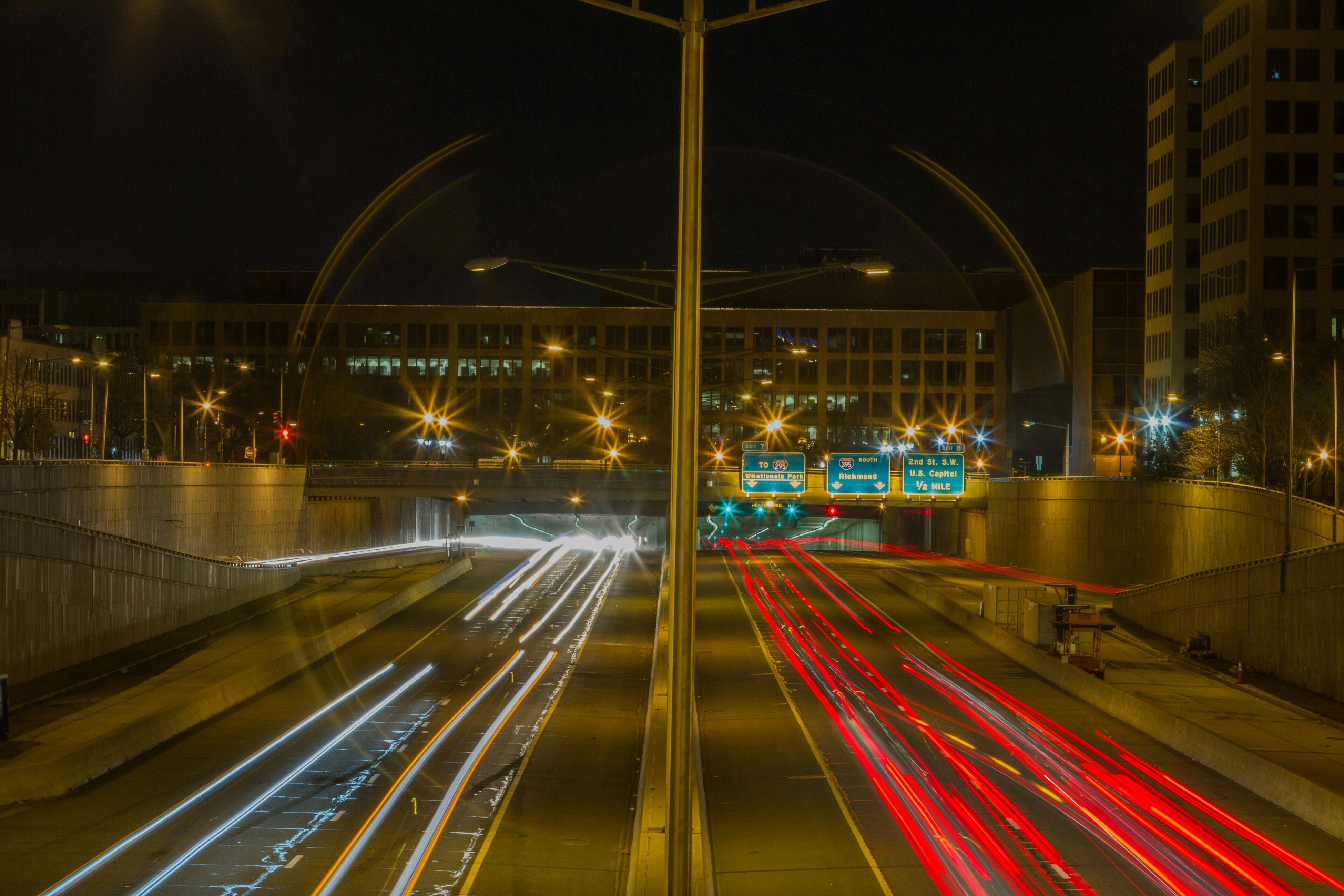 illuminated, night, long exposure, light trail, transportation, speed, motion, street light, city, blurred motion, road, traffic, built structure, architecture, lighting equipment, building exterior, street, city life, on the move, car