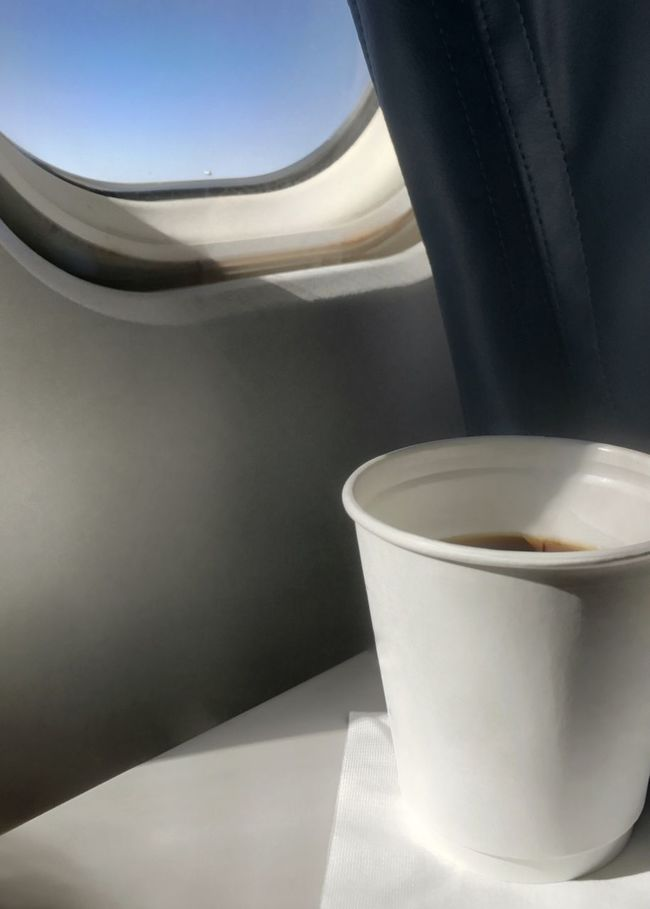 Coffee on a plane to somewhere. Travel Jet Jet Window Coffee Food And Drink Flying Flight Air Travel  Drink No People Table Refreshment Freshness Day Blue Sky View From The Window... Tray Table Tourism Limited Palette Paper Cup Window Window Seat Visual Feast