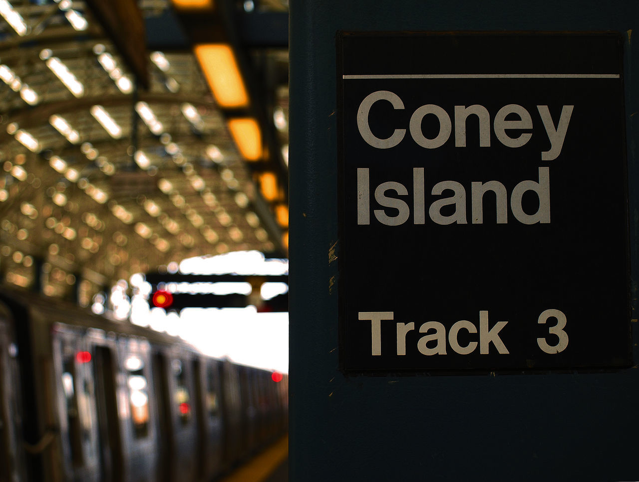 Close-Up Of Coney Island Text At Railroad Station