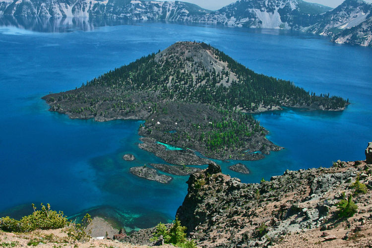 Crater Lake Crater Lake, Oregon Wizard Island, Crater Lake Aerial View Beauty In Nature Blue Day High Angle View Landscape Mountain Nature No People Outdoors Physical Geography Rock - Object Scenics Sea Sky Tranquil Scene Tranquility Travel Destinations Tree Water
