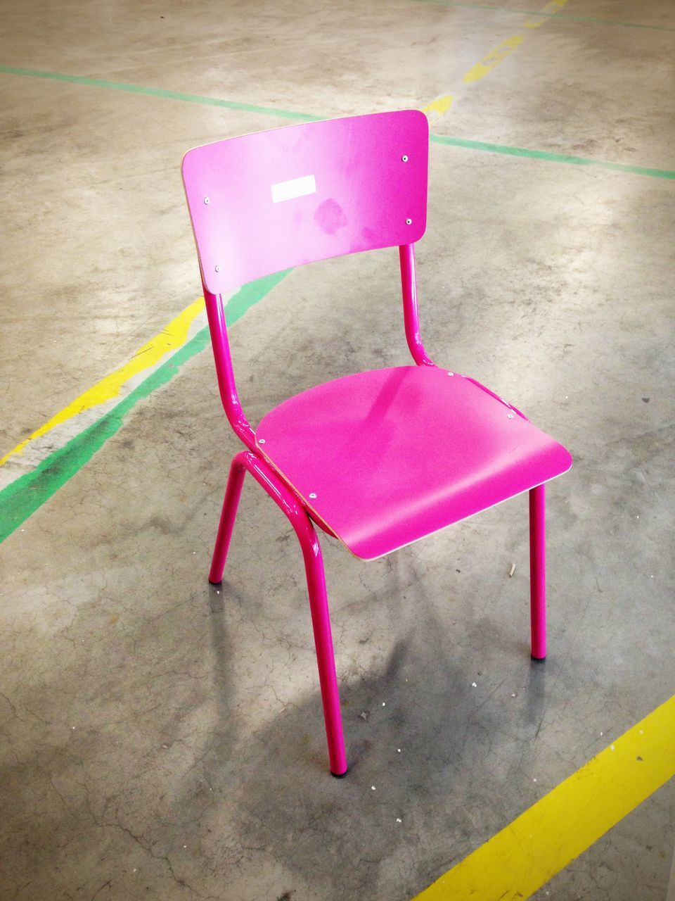 Empty pink chair in a room