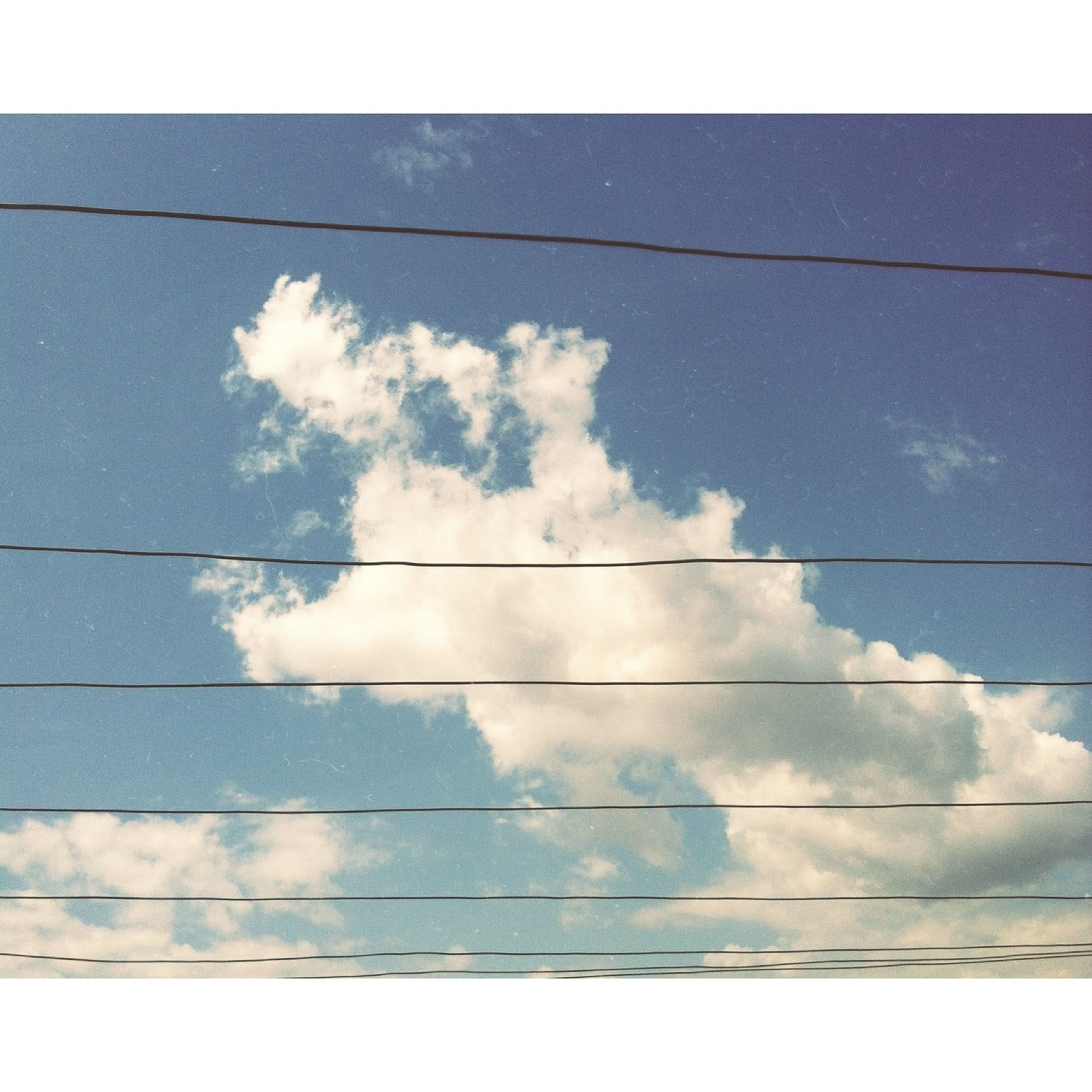 power line, sky, low angle view, power supply, electricity pylon, cable, cloud - sky, electricity, connection, transfer print, cloud, cloudy, fuel and power generation, blue, power cable, auto post production filter, nature, day, no people, technology