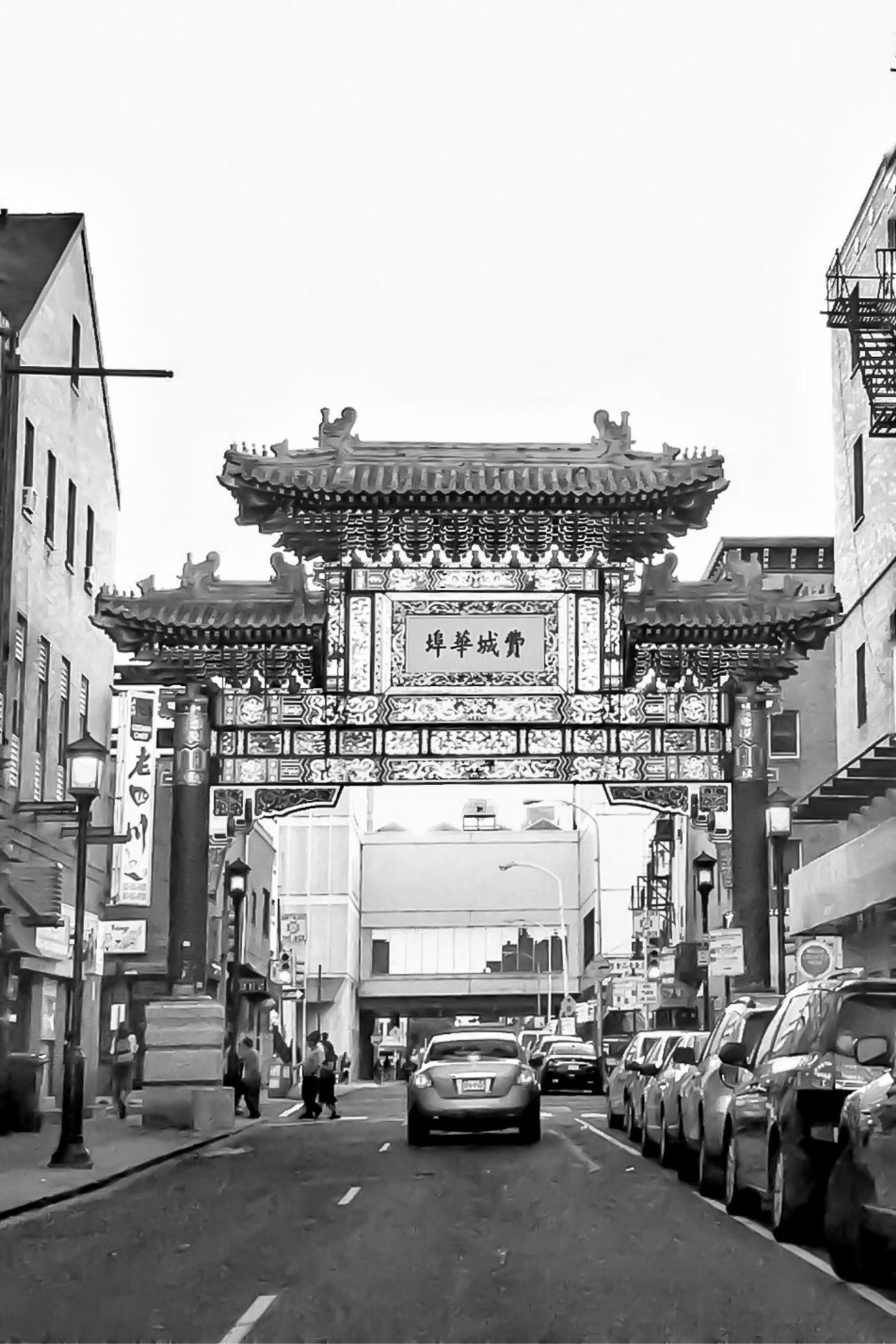 An IPhone in China Town. Building Exterior Architecture City Built Structure Transportation Land Vehicle Mode Of Transport Car Sky Outdoors City Life Day No People City Gate China Town Philadelphia Streamzoofamily IPhone Photography Iphonephotography IPhoneography Iphoneonly IPhone Iphonesia Blackandwhite Black And White