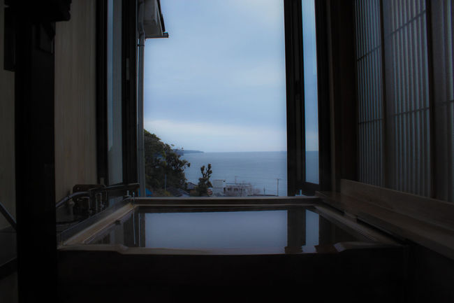 Bath time Architecture Balcony Bath Bathtub Blue Building Exterior Built Structure Cloud Dark Day Glass Indoors  Japan No People Ocean Onsen Railing Sea Sky Tourist Resort Water Window