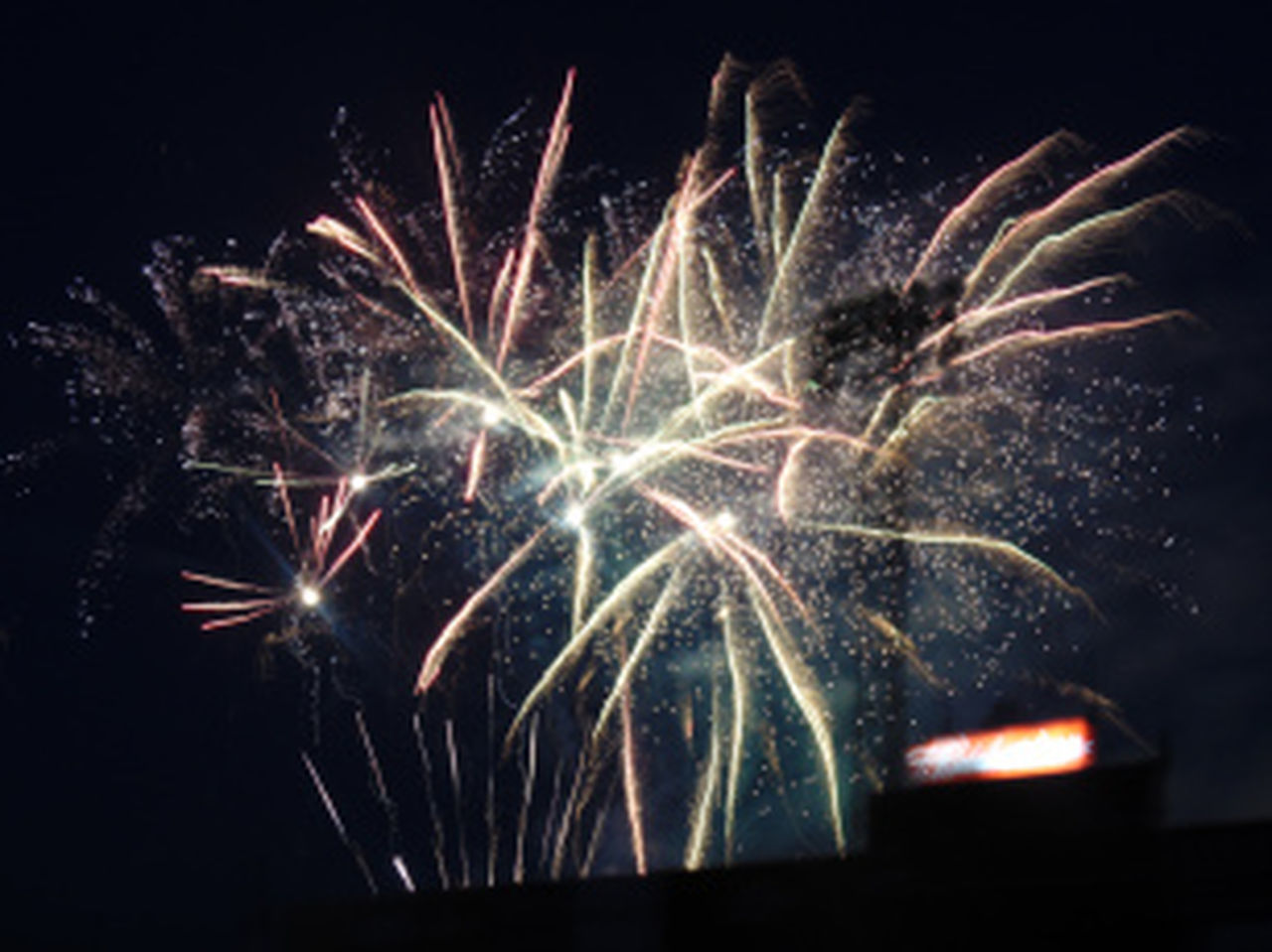night, firework display, firework - man made object, exploding, celebration, long exposure, arts culture and entertainment, illuminated, no people, black background, multi colored, sky, outdoors, close-up