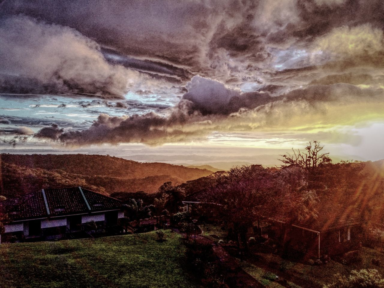 sky, house, cloud - sky, built structure, no people, dramatic sky, nature, architecture, beauty in nature, outdoors, building exterior, scenics, tree, mountain, landscape, storm cloud, grass, day, sunset