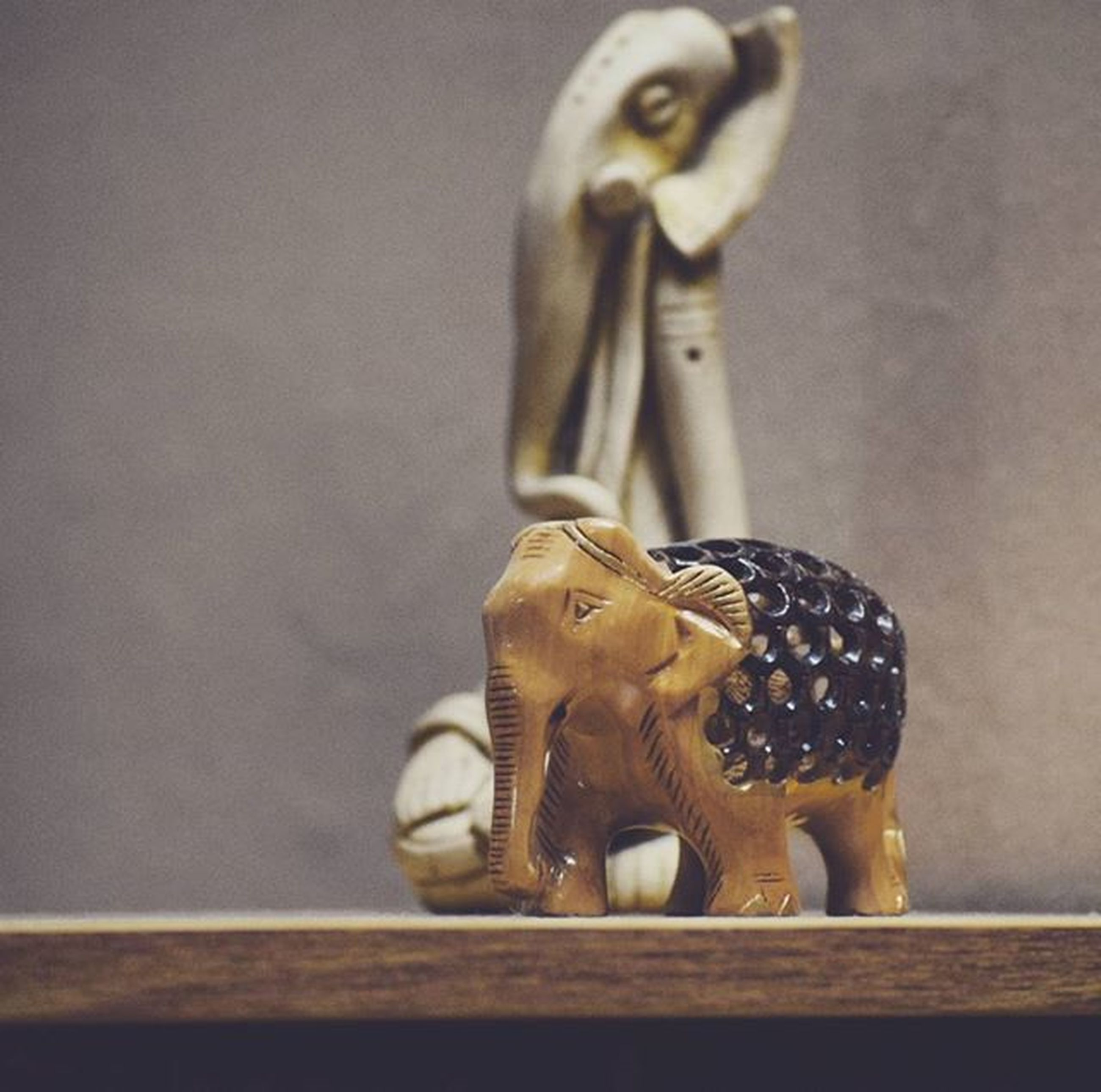 art and craft, human representation, statue, art, sculpture, creativity, animal representation, close-up, indoors, focus on foreground, carving - craft product, figurine, no people, craft, ornate, wall - building feature, gold colored, day
