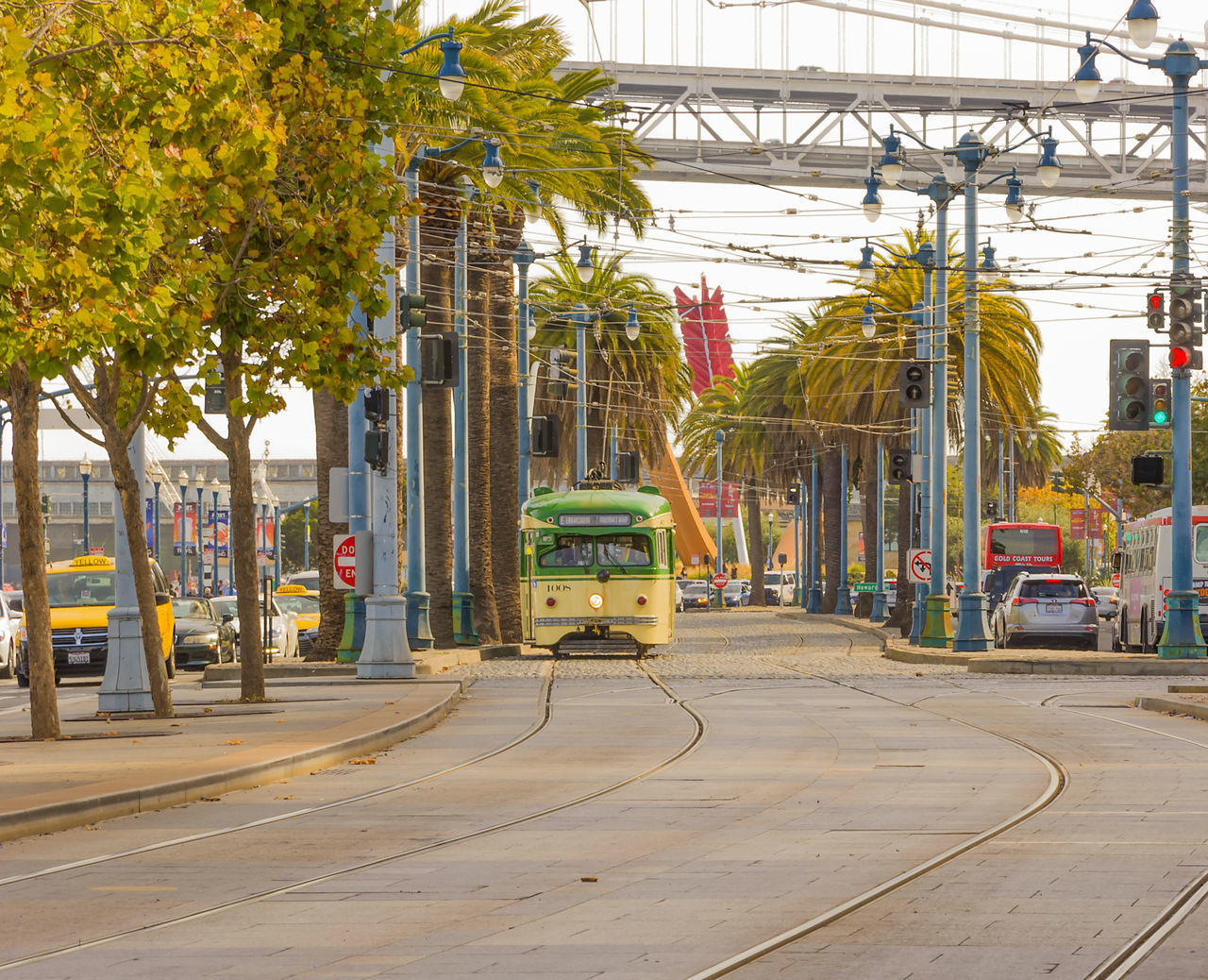Tram in San Francisco waiting to move Architecture Business Finance And Industry City Day Greenhouse Industrial Building  Industry Long Angle View Moving No People Outdoors Tourism Tram Transportation Tree