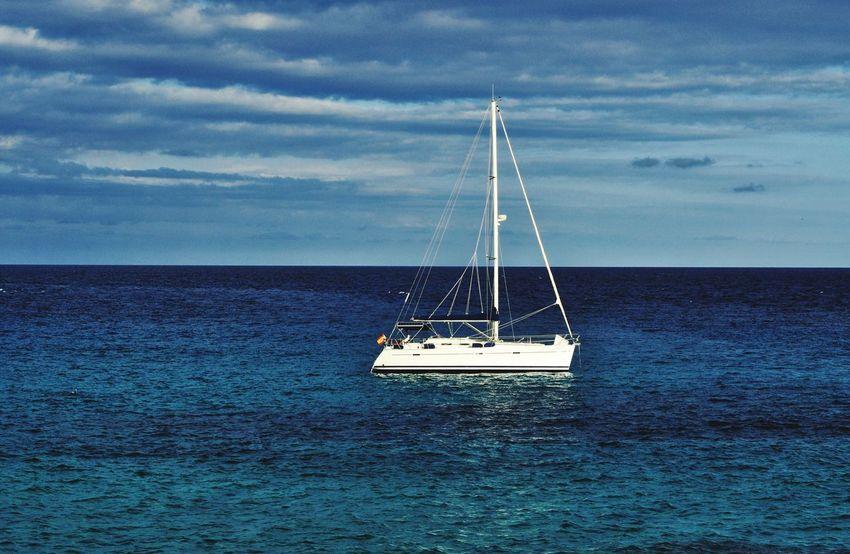 EyeEm Selects yacht in cala varques on mallorca balearic island in spain Sea Nautical Vessel Sailboat Sailing Water Yacht Cloud - Sky Beach Vacations Outdoors Mast Sailing Ship Idyllic Mediterranean  Travel Destinations Mallorca Majorca Island Cala Varques