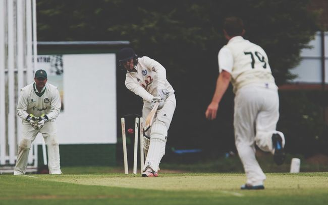 Cricket bowler taking a wicket and hitting stumps Cricket! Cricket Field Cricketers Wicket Wicketkeeper Howzat Sports Sports Photography England Amature Ball Cricket Ball Cricket Pitch Batsman Helmet Protection Team Teamwork Sucess