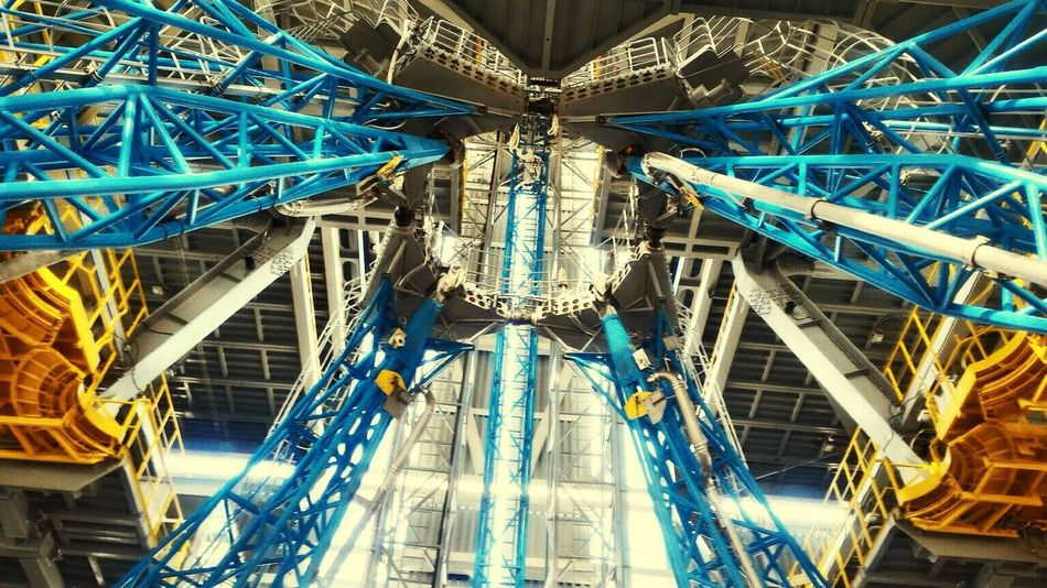 Amusement Park Amusement Park Ride Architecture Blue Built Structure Full Frame Low Angle View Modern No People Sky Skyscraper Tall Tall - High Tourism Tower