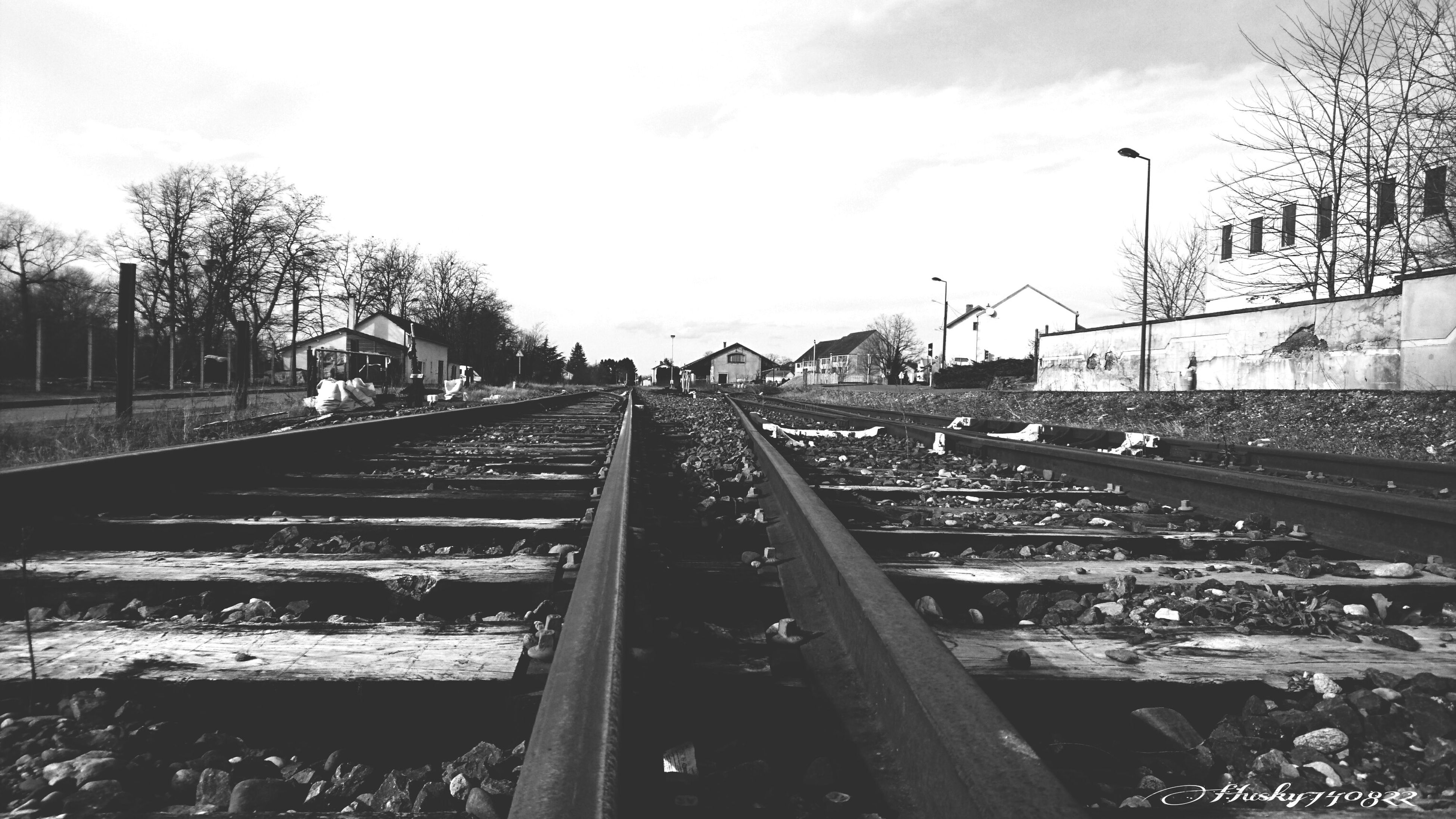 railroad track, rail transportation, transportation, sky, outdoors, day, tree, no people, architecture