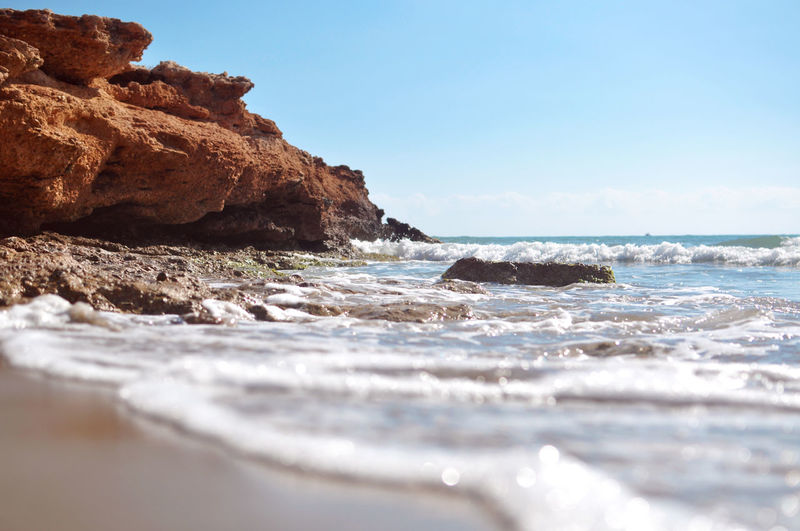 Beach Beauty In Nature Blue Day Horizon Over Water Nature Outdoors Peñíscola Rock - Object Rock Formation Sand Sea Selective Focus Sky Surface Level Tranquil Scene Tranquility Water Wave