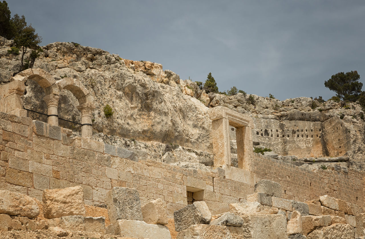 Alahan Monastery Alahan Monastery Alahan The Monastery Arches Byzantine Architecture Cliffside Faithful Historical Building Historical Monuments Historical Sights History Mut Religious  Religious Architecture Sky And Clouds Stone Travel Destinations Turkey