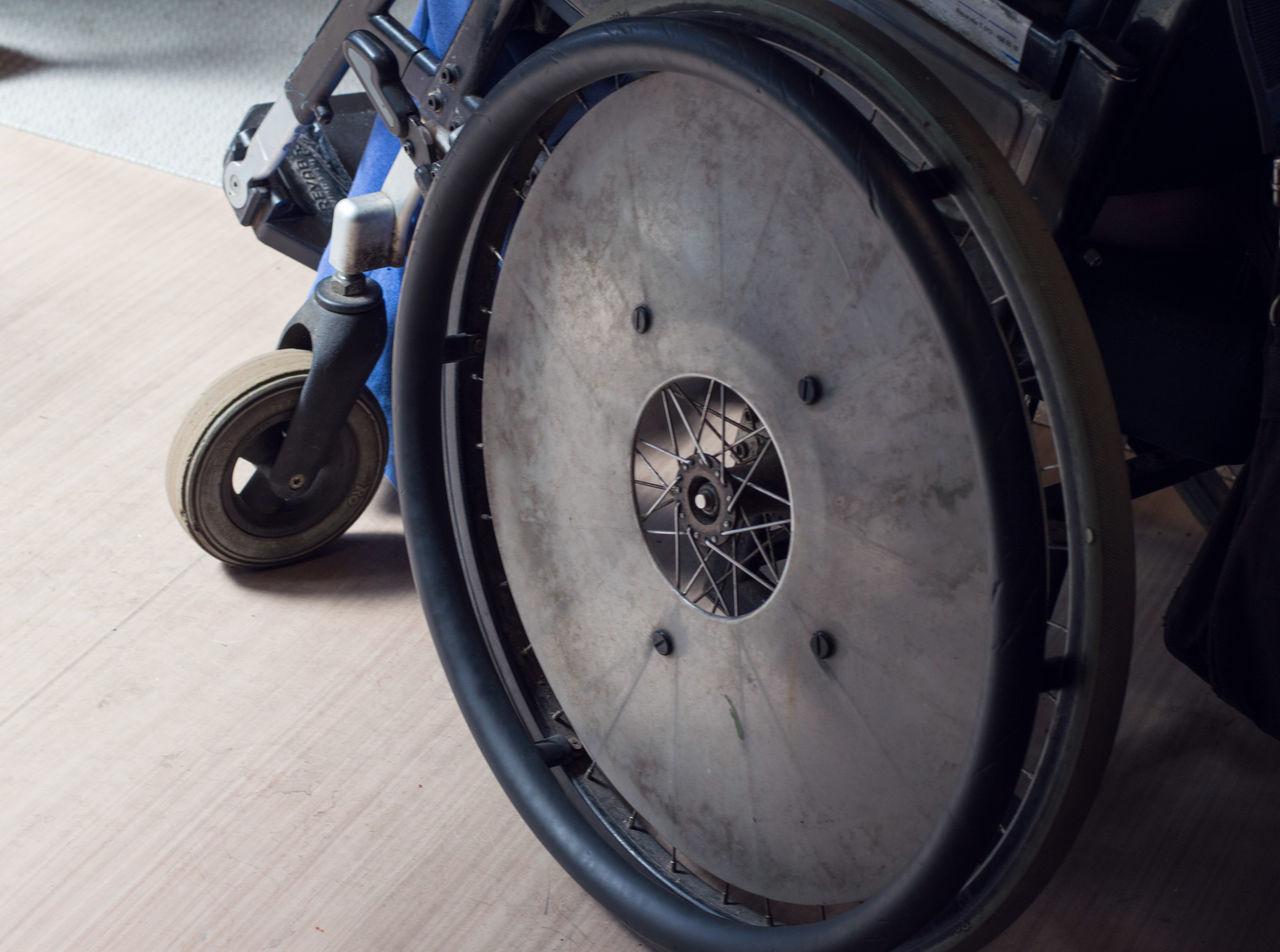 High Angle View Of Wheelchair On Hardwood Floor