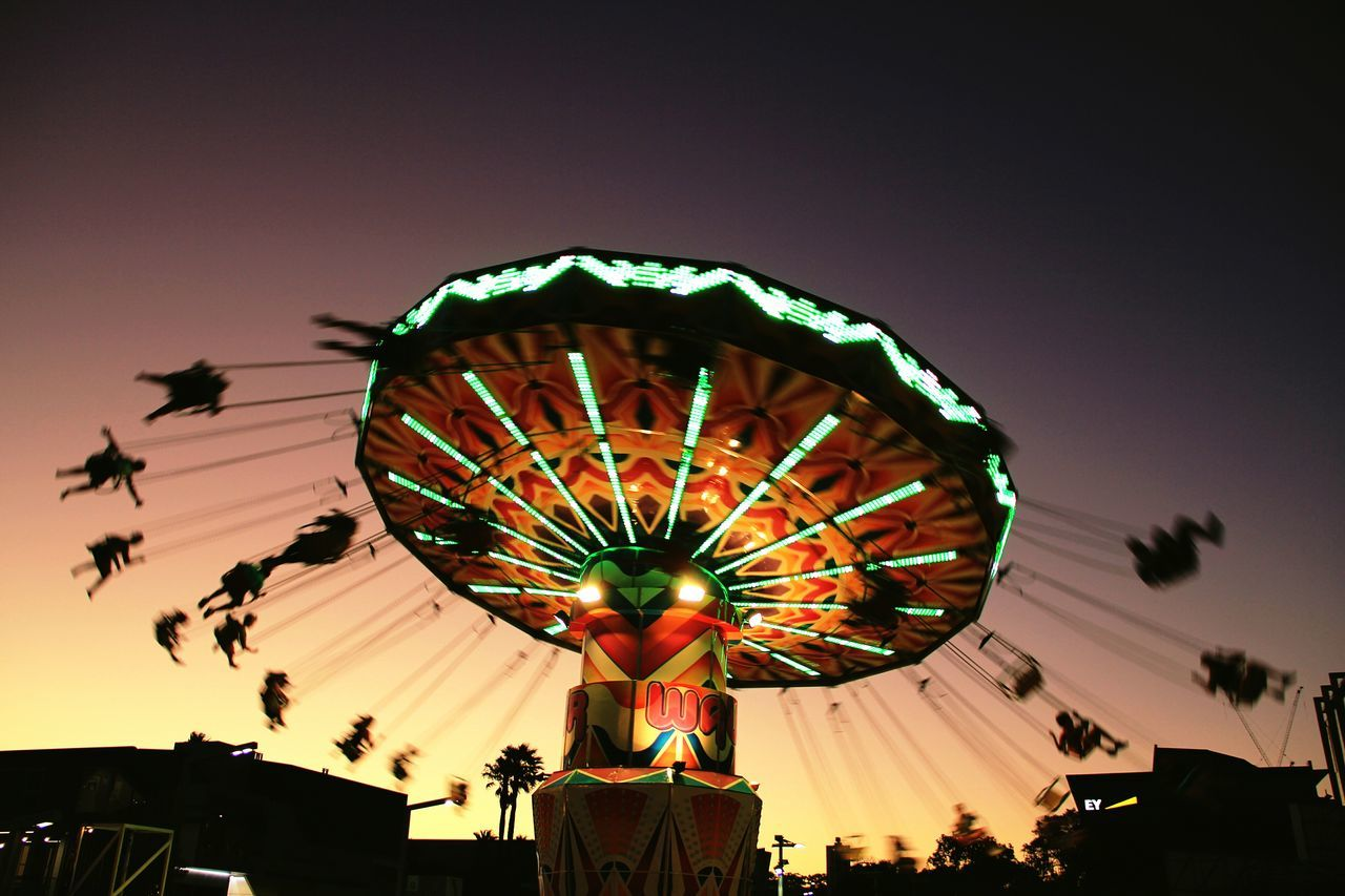 Wave Swinger into the Sunset at Fringe Festival on Elisabeth Quay, Perth | Fun Australia Colours Of Summer Light And Shadow Silhouette Sunset Silhouettes People Photography Photography In Motion Cities At Night Feel The Journey Flying Fair Fairground