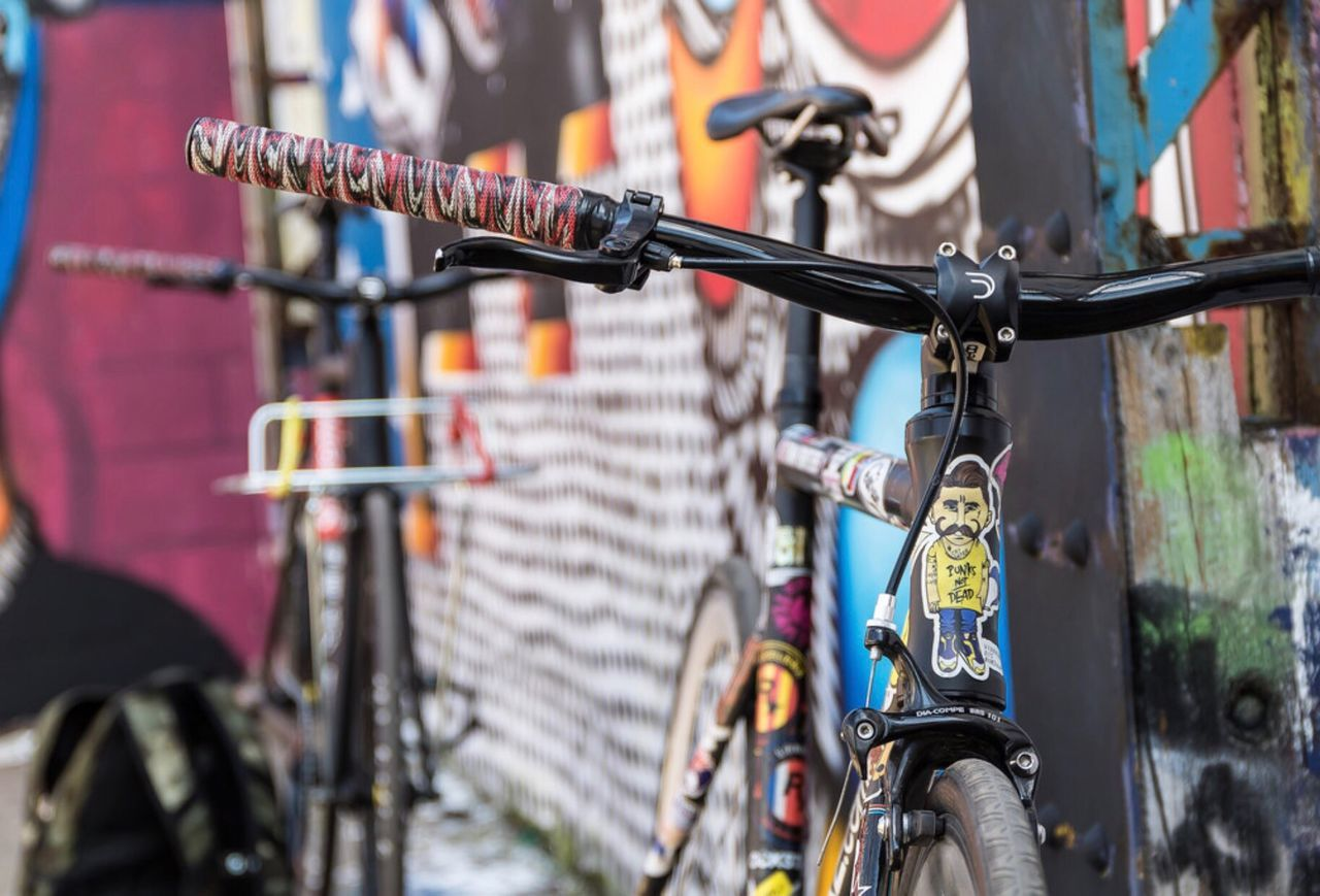 bicycle, hanging, metal, outdoors, transportation, close-up, day, city, land vehicle, no people, architecture