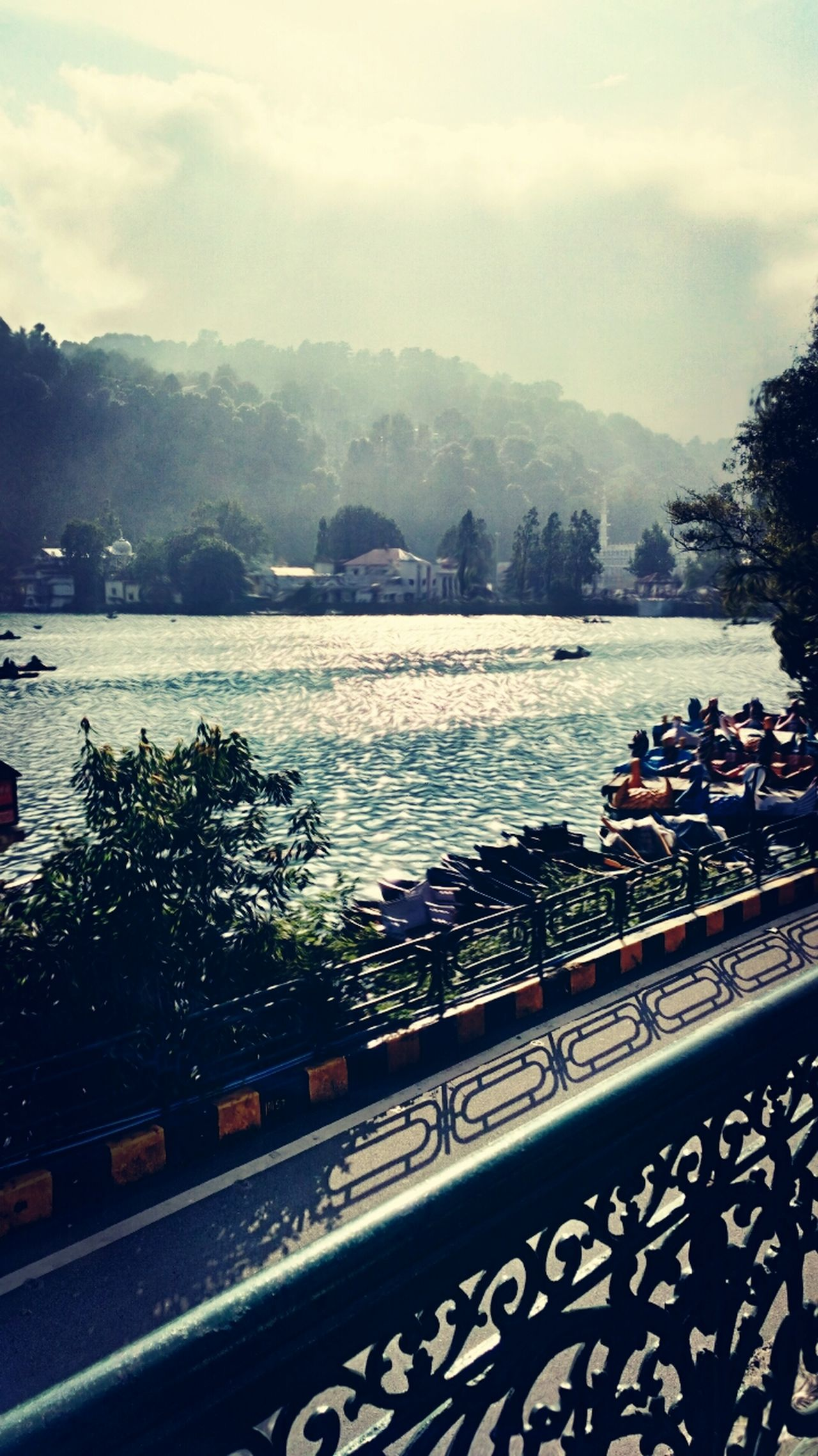 A bEauTiful pIc bY mE Of nAini jhEel in nAiniTaL.... Scenics Tree Water Scenics Tranquil Scene Tranquility Mountain Sky Cloud River Town Day Nature Beauty In Nature Outdoors Non-urban Scene Calm Solitude Riverbank Mountain Range Cloud - Sky First Eyeem Photo