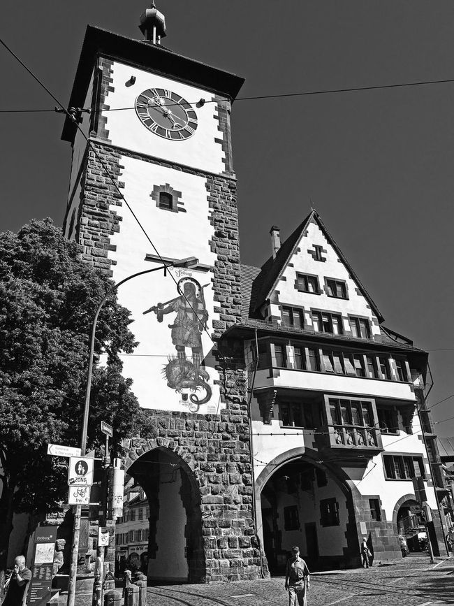 Arch Architecture Black And White Building Exterior Built Structure Capital Cities  City City Life Clear Sky Clock Tower Day Famous Place Freiburg Germany, History In Front Of Local Landmark Low Angle View Outdoors Sky Tall Tall - High Tourism Tower Travel Destinations