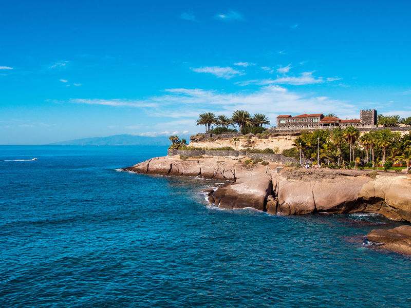 View of ancient castle. Located between El Duque and Fanabe beaches in Tenerife. Canary Islands. Spain Atlantic Ocean Canary Islands Coastline El Duque Beach Holiday Rocky Coastline SPAIN Sunlight Vacations Beauty In Nature Beauty In Nature Coast Day Landscape Nature Outdoors Palm Trees Picturesque Sea Sky Sunny Day Tenerife Tenerife Island Tourist Resort Water