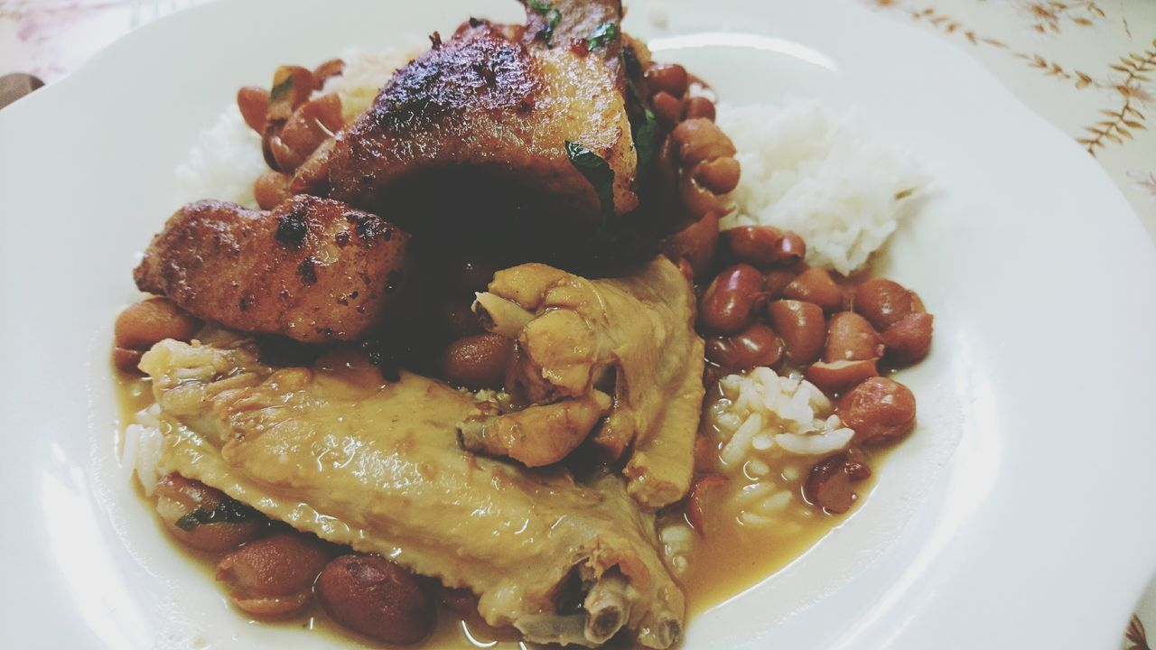 Lunch Time! some Surinam Food Brown Beans with Rice Pork and Chicken. Food Photography Foodilicious