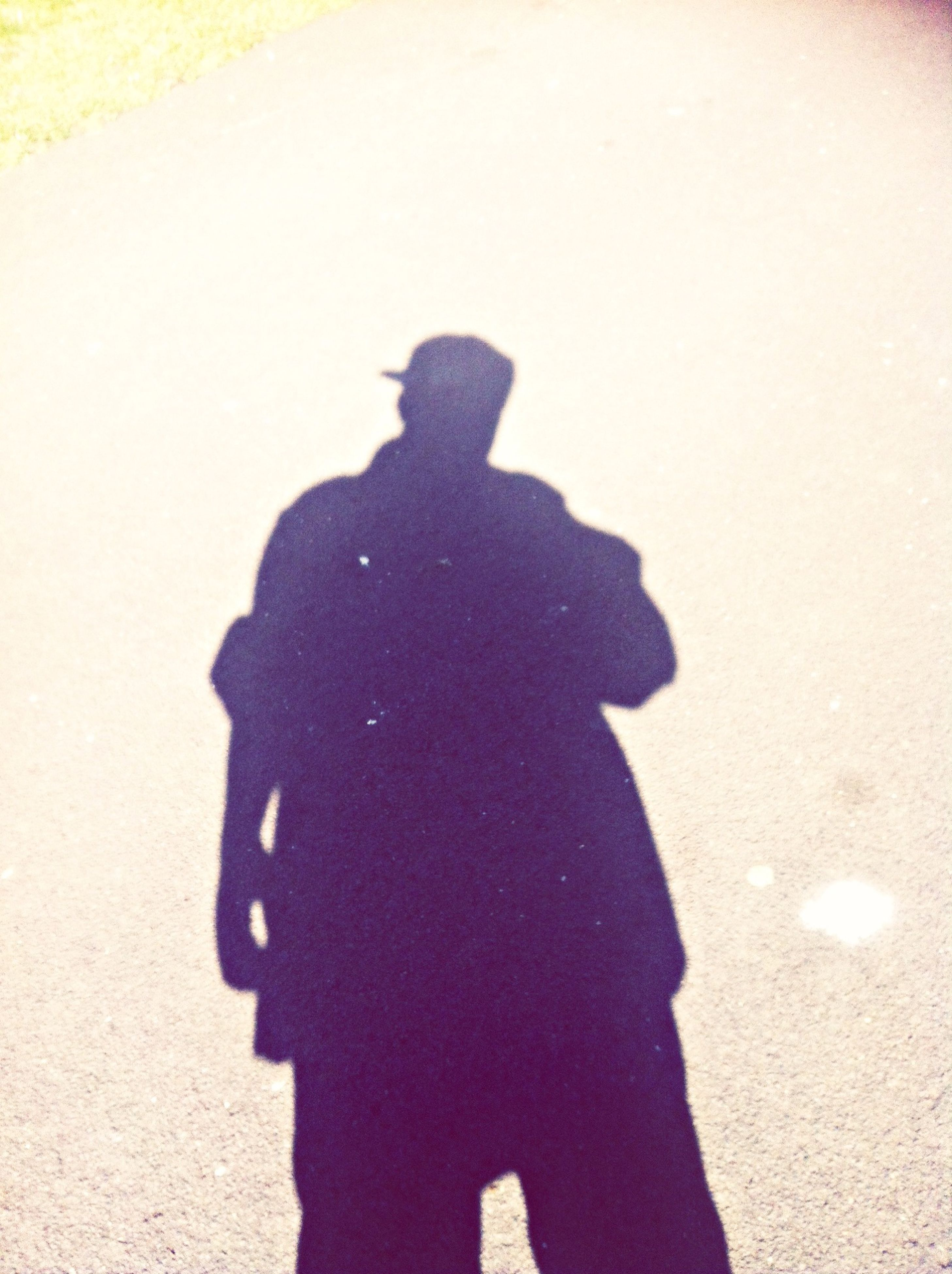 shadow, men, lifestyles, street, leisure activity, focus on shadow, silhouette, standing, sunlight, unrecognizable person, holding, road, three quarter length, high angle view, outdoors, day, person