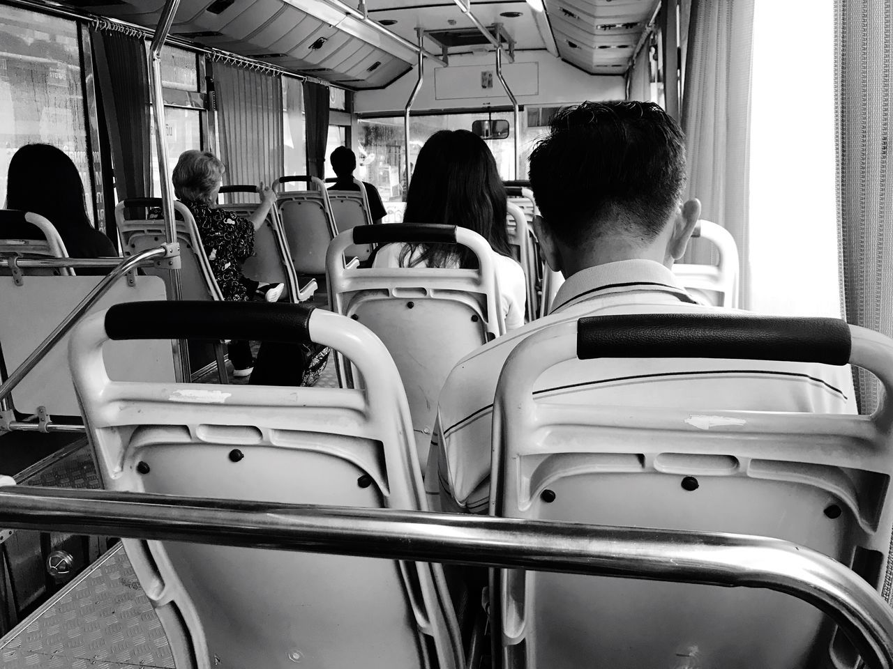 Bus People Sit Sitting Vehicle Interior Transportation Public Transportation Vehicle Seat Mode Of Transport Train - Vehicle Men Real People Passenger Bus Subway Train Indoors  Women Commuter Train Day Commuter Large Group Of People Young Adult Young Women