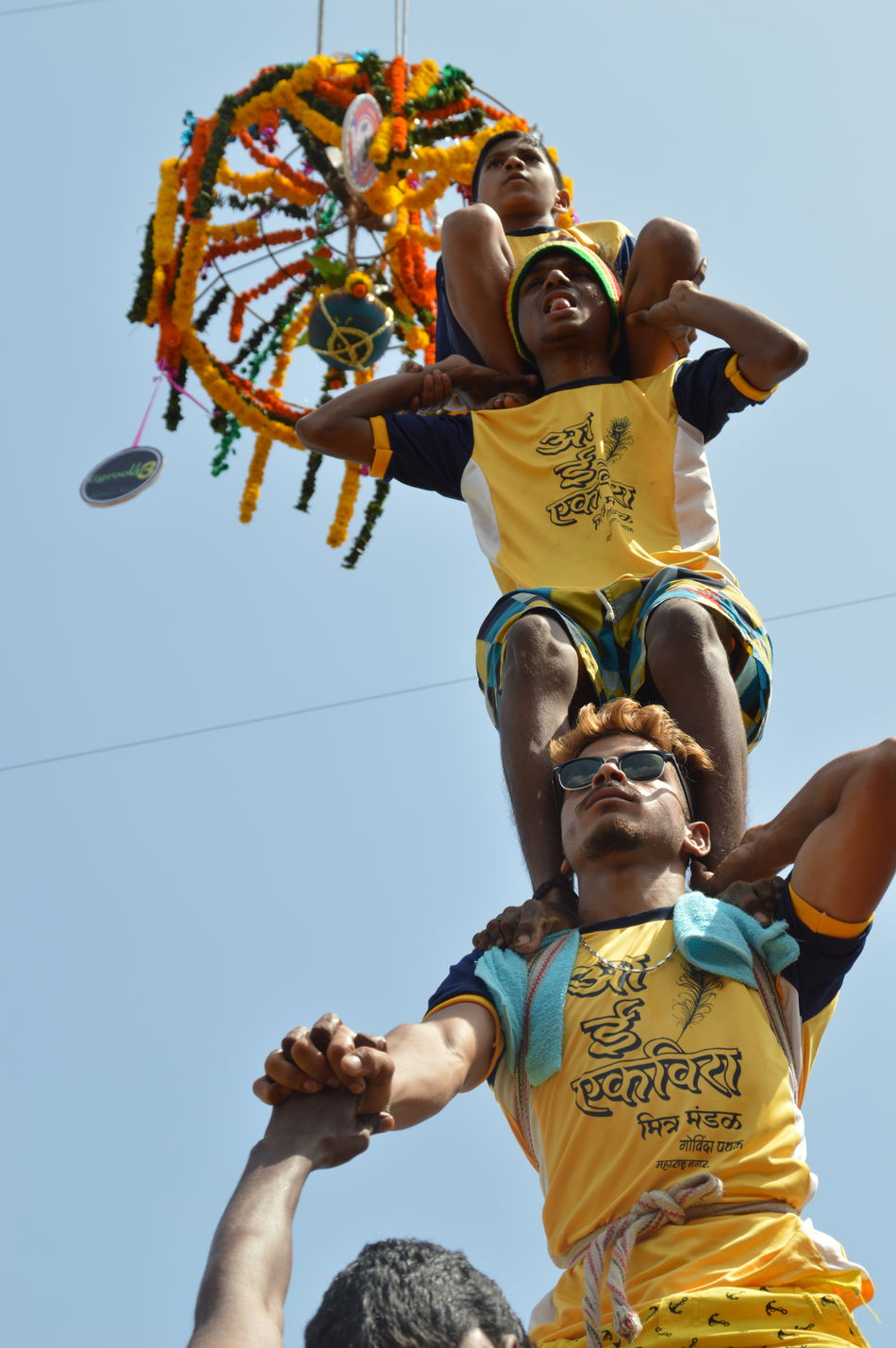 human pyramid Clear Sky Colors Dahi Handi Day Festival Festive Season Human Figures Drawn Human Pyramid  Low Angle View Memories Outdoors Sky Tourism Yellow Young Adult