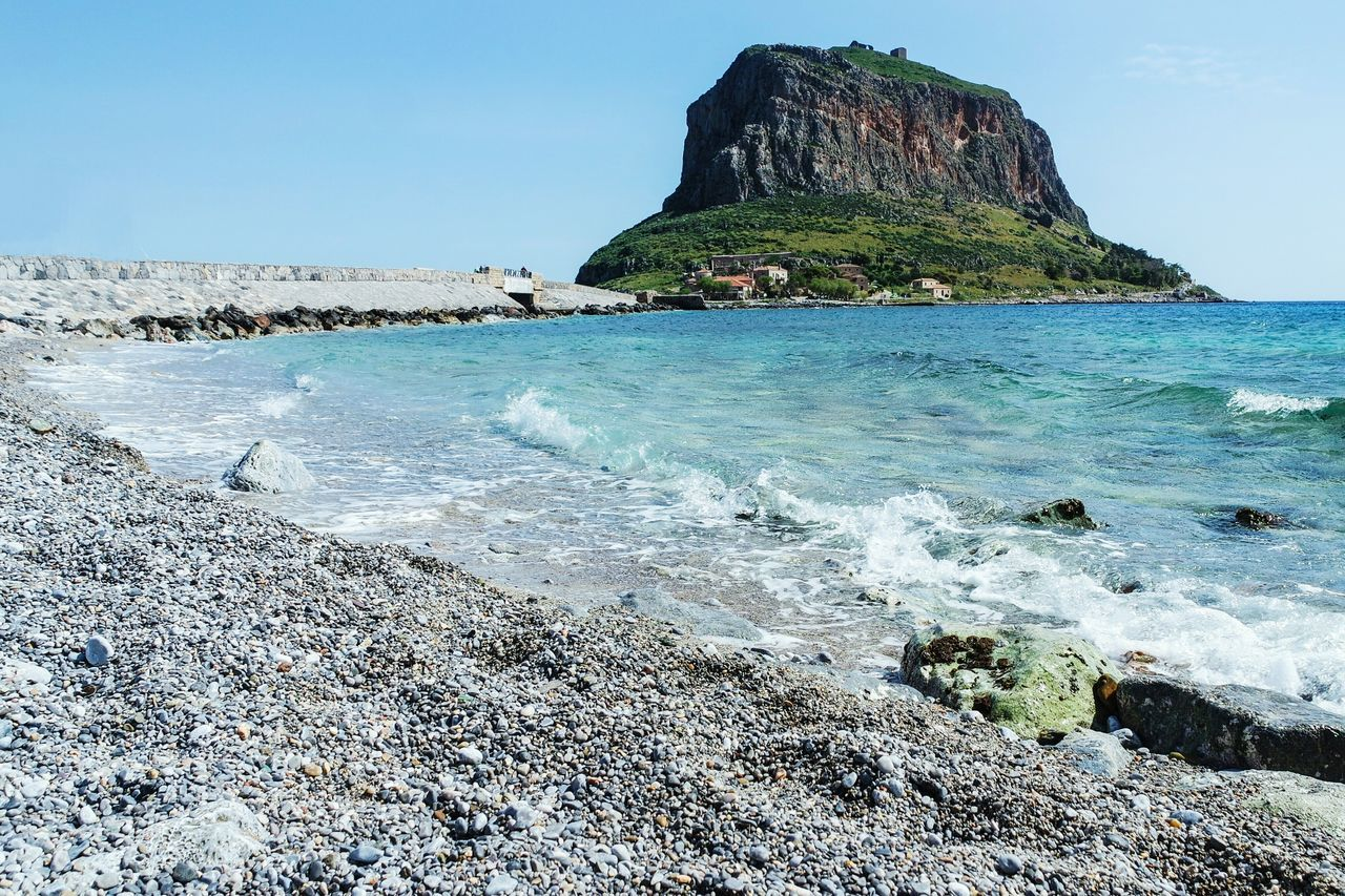 sea, rock - object, rock formation, nature, scenics, beauty in nature, tranquil scene, outdoors, water, tranquility, beach, rock, day, cliff, idyllic, sky, no people, mountain, travel destinations, clear sky, horizon over water