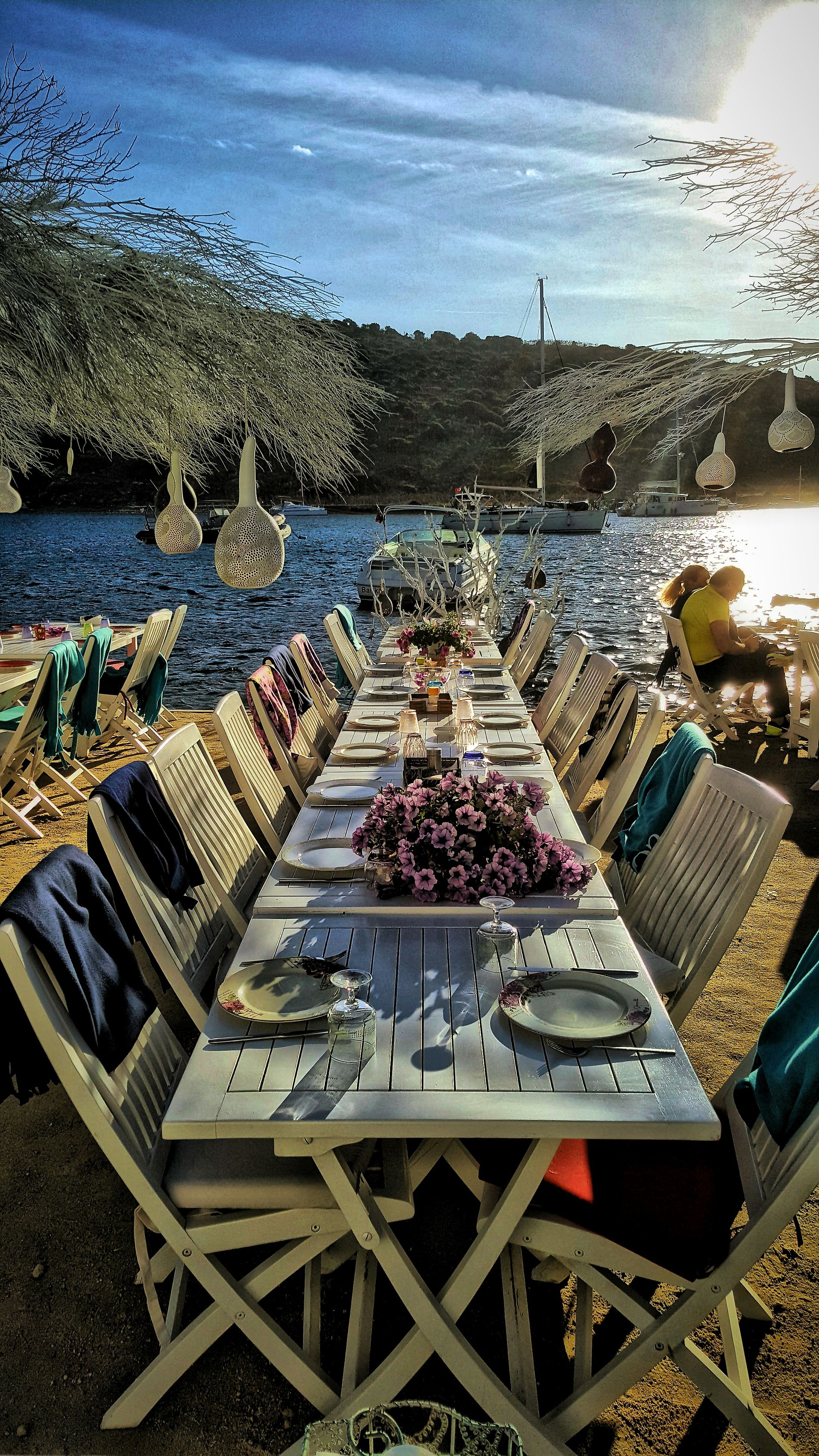 table, water, food and drink, food, plate, no people, sea, nature, sky, outdoors, horizon over water, chair, day, place setting, scenics, beauty in nature, ready-to-eat, healthy eating, freshness