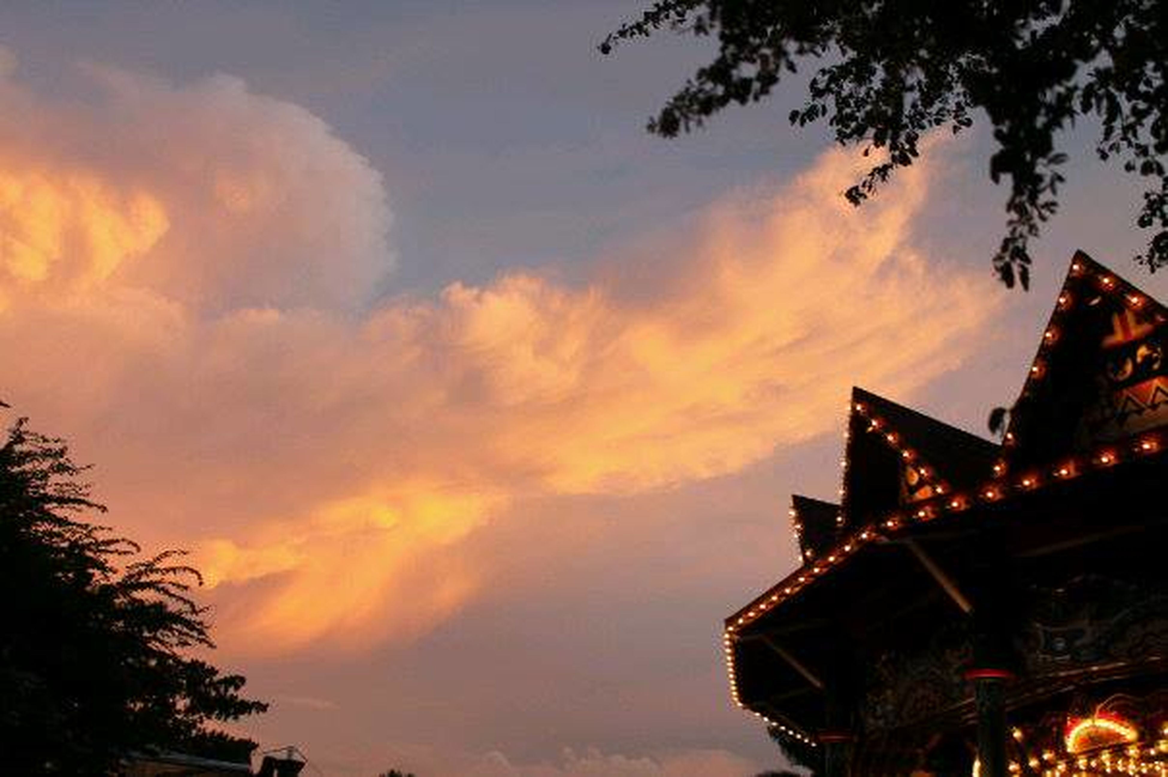 architecture, building exterior, built structure, sky, low angle view, sunset, cloud - sky, silhouette, tree, dusk, cloudy, religion, place of worship, cloud, high section, outdoors, spirituality, orange color, building, no people